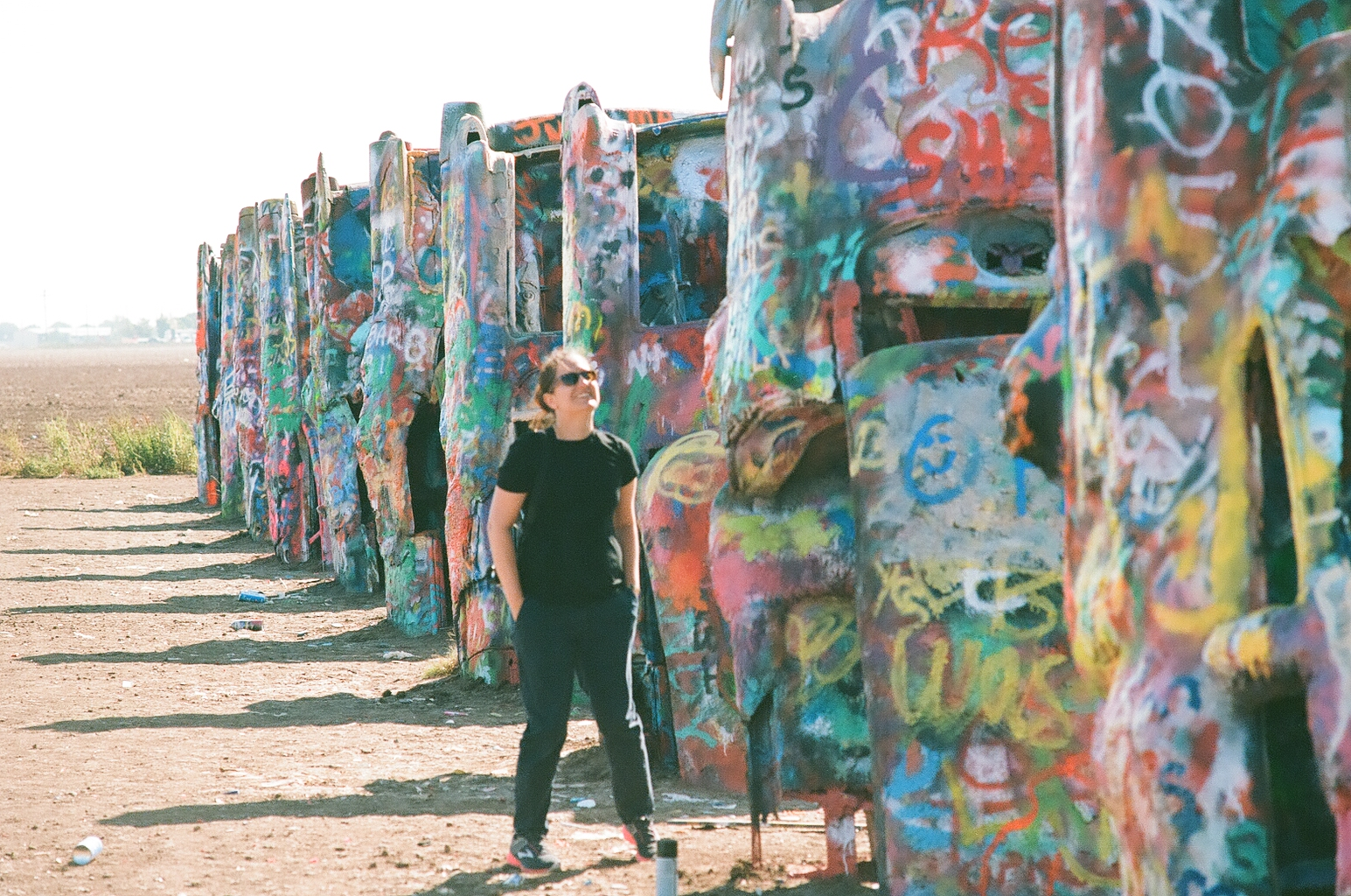 Michelle in New Mexico next to some graffiti art.