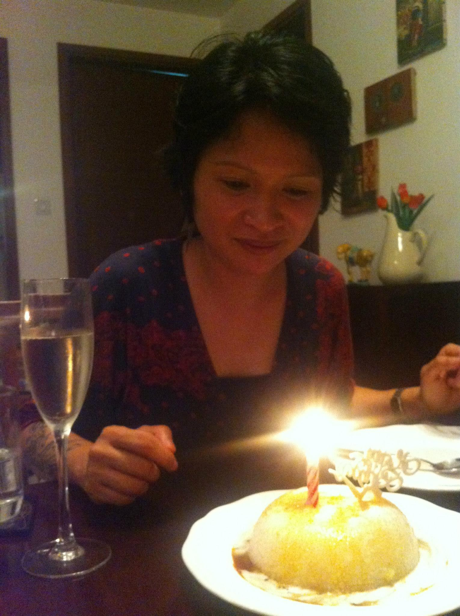 Lyra having a Birthday dinner prepped by flatmates in Singapore.