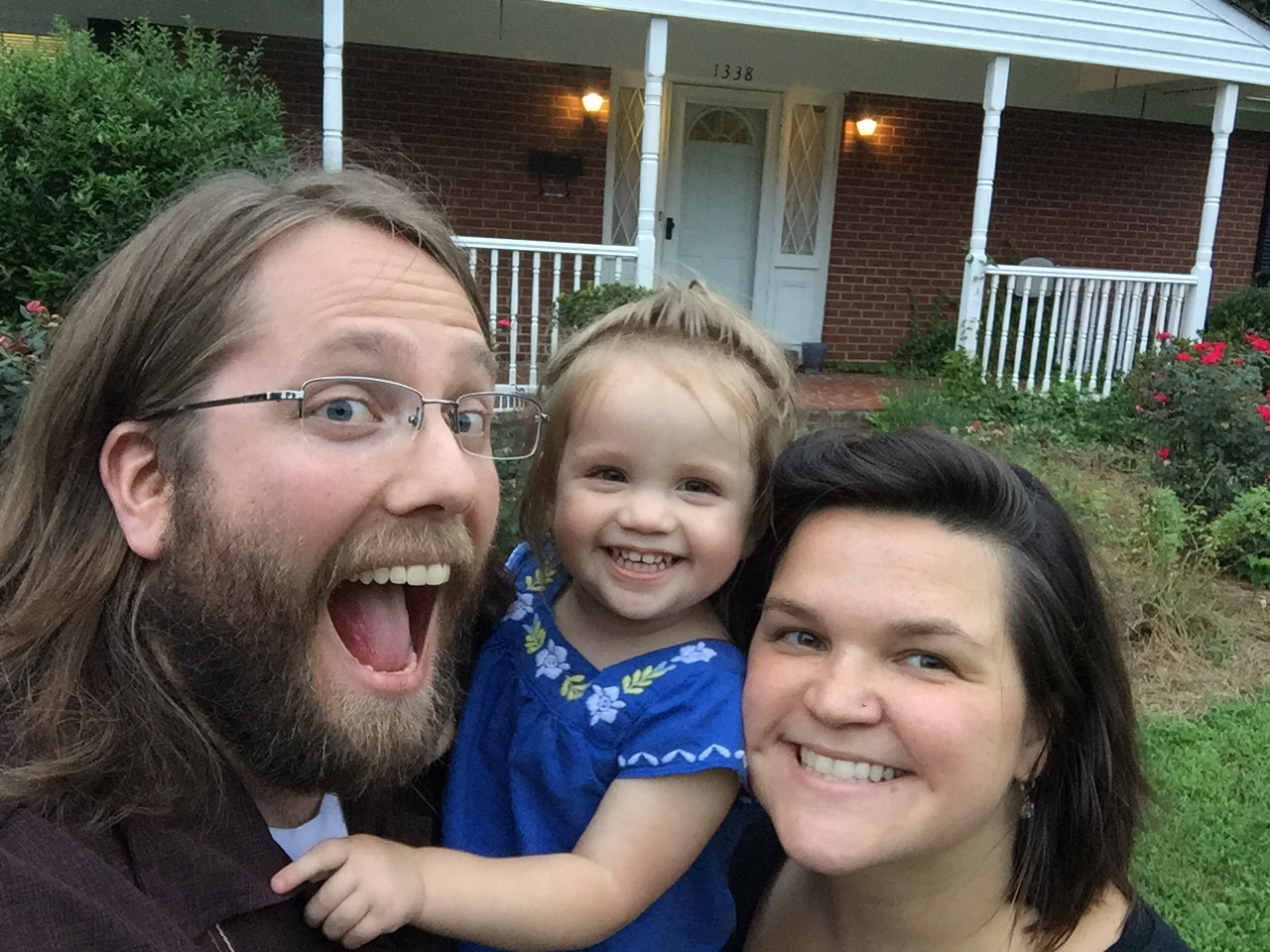(from left to right) Evan, Robin (their daughter), and Lauren (his Wife) seen here in front of their older house in NC.