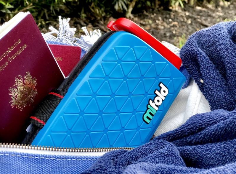 We love being able to carry MiFold in our back pocket, especially when time comes to get all luggages out of the rental car and collecting seats. It is one less thing in our hands.   The MiFold is super portable and adapts to the sizes of all of our children. We're able to fit all 3 kids in a row – another big win when renting a car outside of the U.S.   The kids think it's comfortable, which is a big win for us!  We typically drive quite a bit during our travel, and we love knowing that the kids are comfy!   And very transparently, who makes such a cool booster for just $35?!    CLICK HERE    to grab one!  They also have a luxury version called MiFoldSPORT, made with leather-style high-end materials.