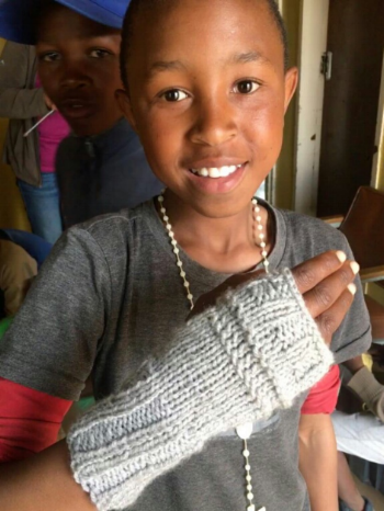Moeketsi's showing off his first knitting success!