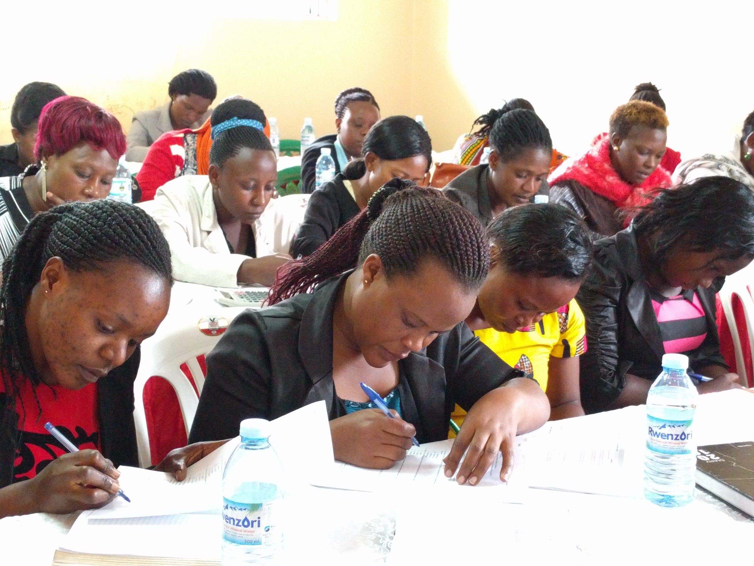BRAC staff members taking a little quiz during the training session
