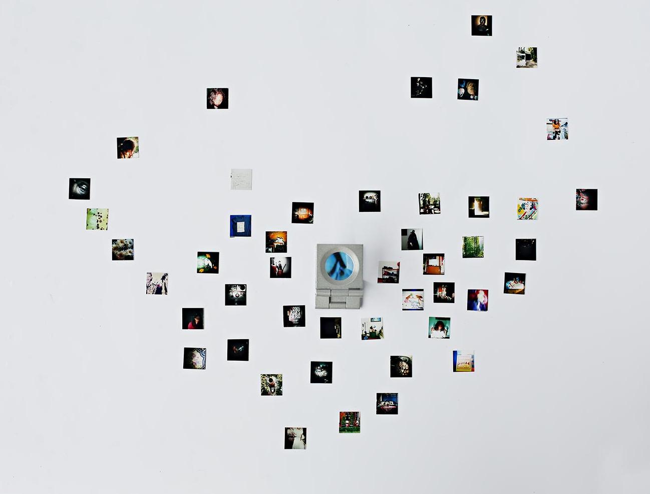 JALAN SEPI (LONELY ROAD):  47 Photographs, 1.5x1.5 cm, Loupe (magnifying glass)