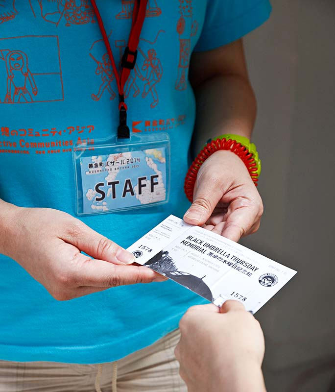 Staff checking out tickets from visitors at Koganecho Bazaar 2014. Yokohama - Japan. Photo by: Masaru Kaido