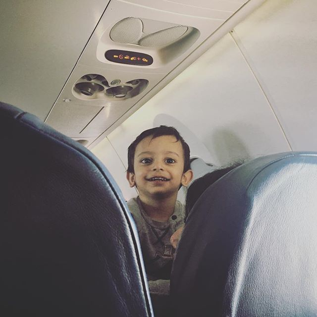 Every time I looked up, this little dude was looking back at me with a huge smile on his face.  Thanks for making my plane ride awesome, kid!