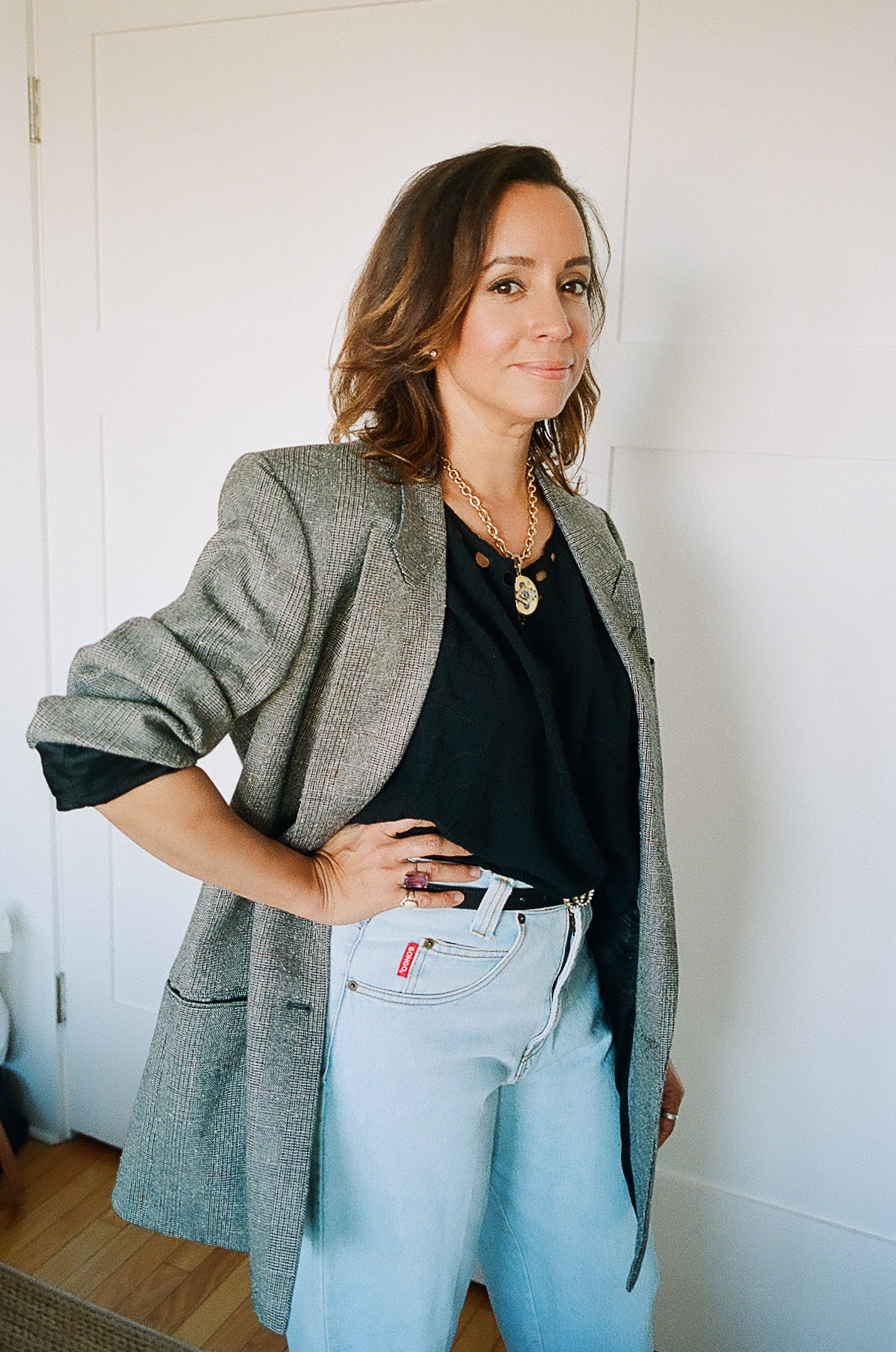Lauren wears an oversized  Encourage vintage blazer  and her own vintage cutout tee + jeans.
