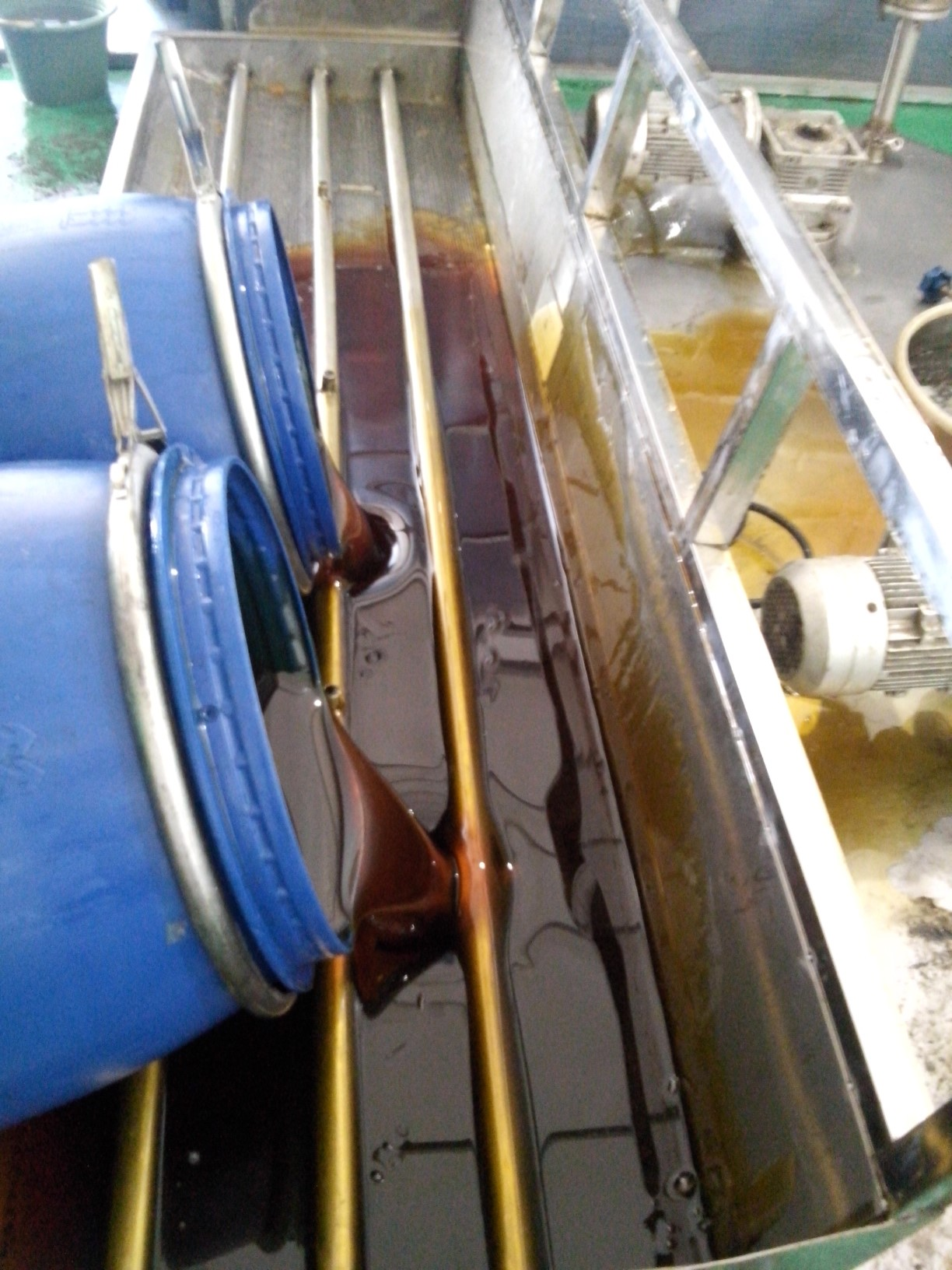 pouring honey into processor