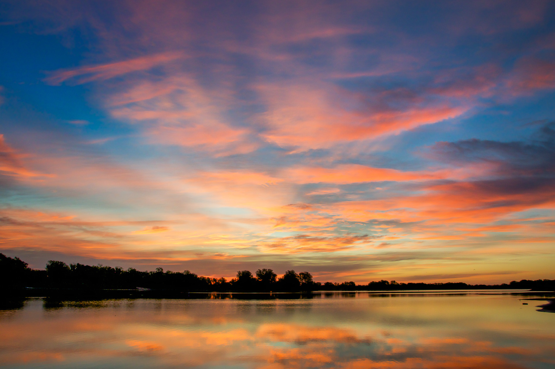 Sunrise reflection at Harvey County East Lake