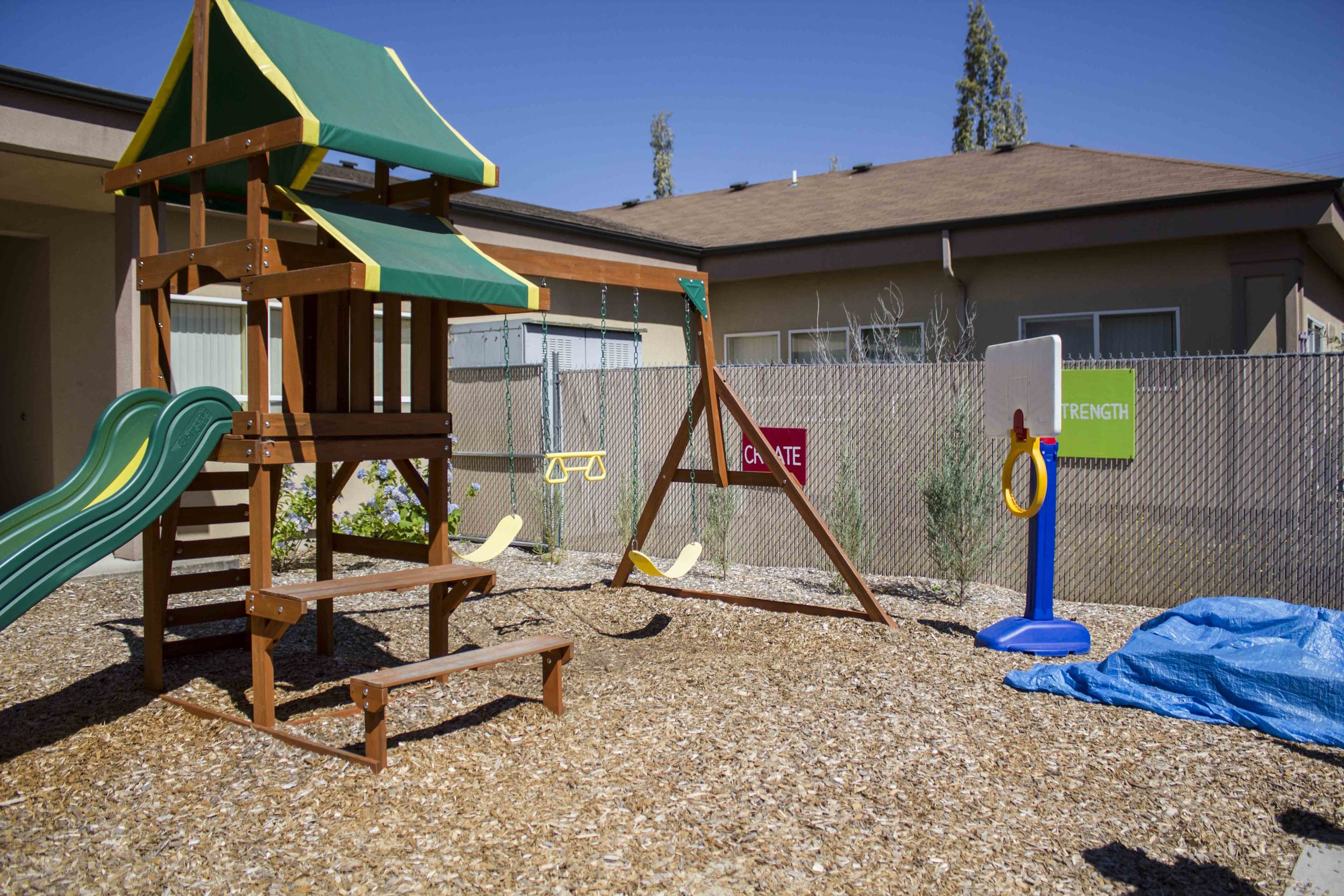 A local bank donated the playground so the kids can have a chance to be kids.