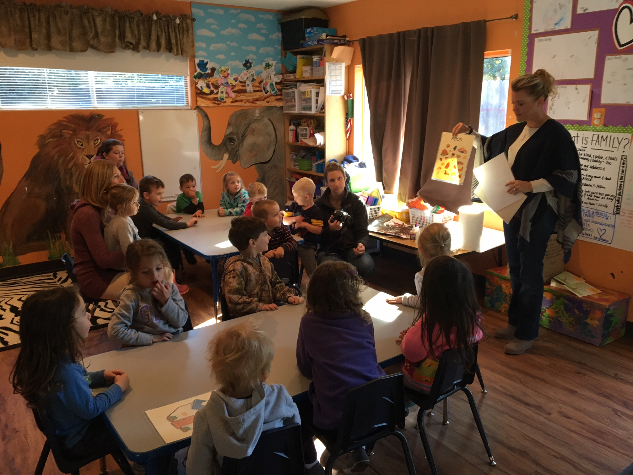 Kelli Plevyak is talking to the students about basic necessities such as a home, food, clothing and a bed to sleep in.