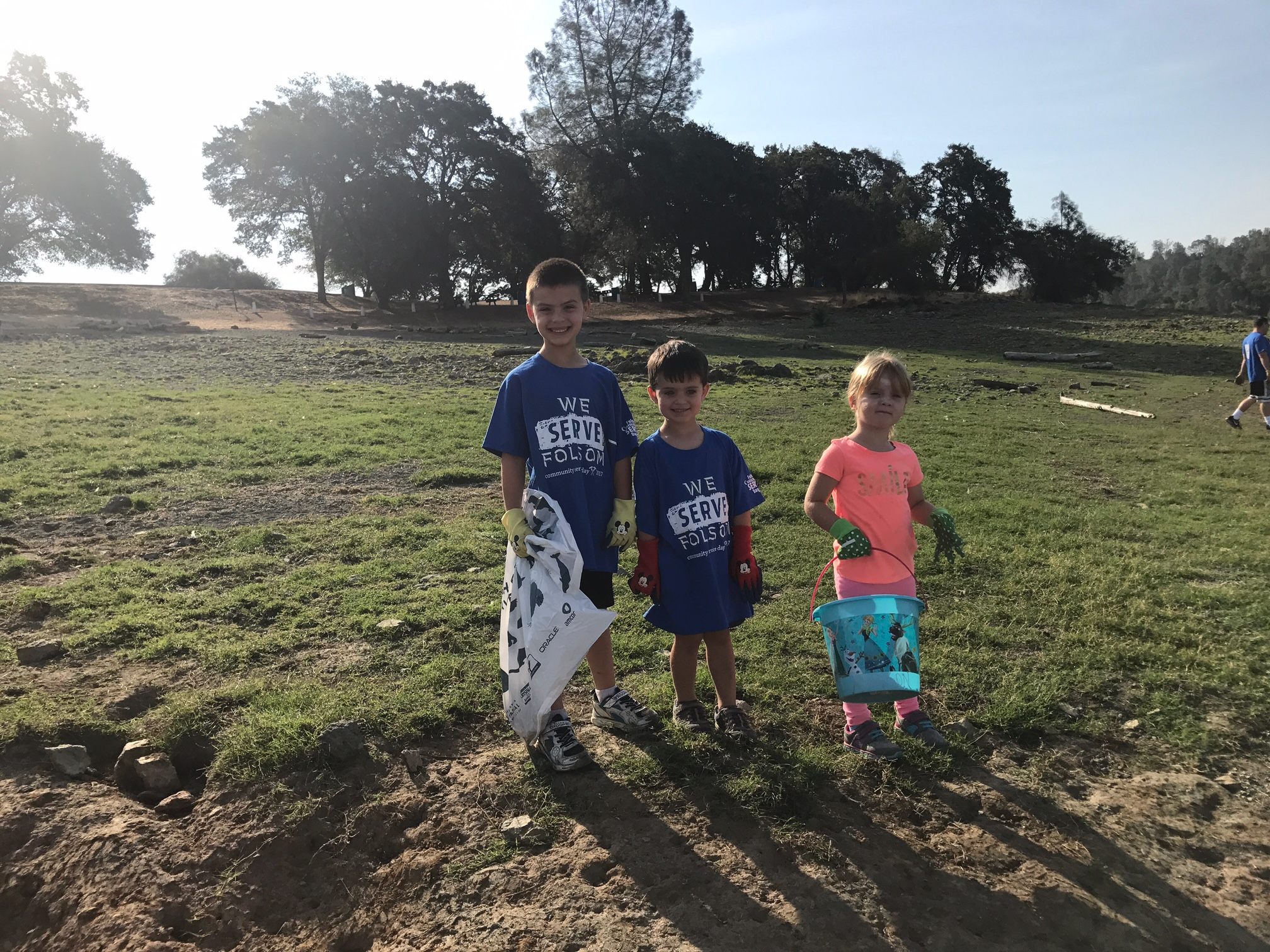 Brayden, Jeren and Addie searching for trash.