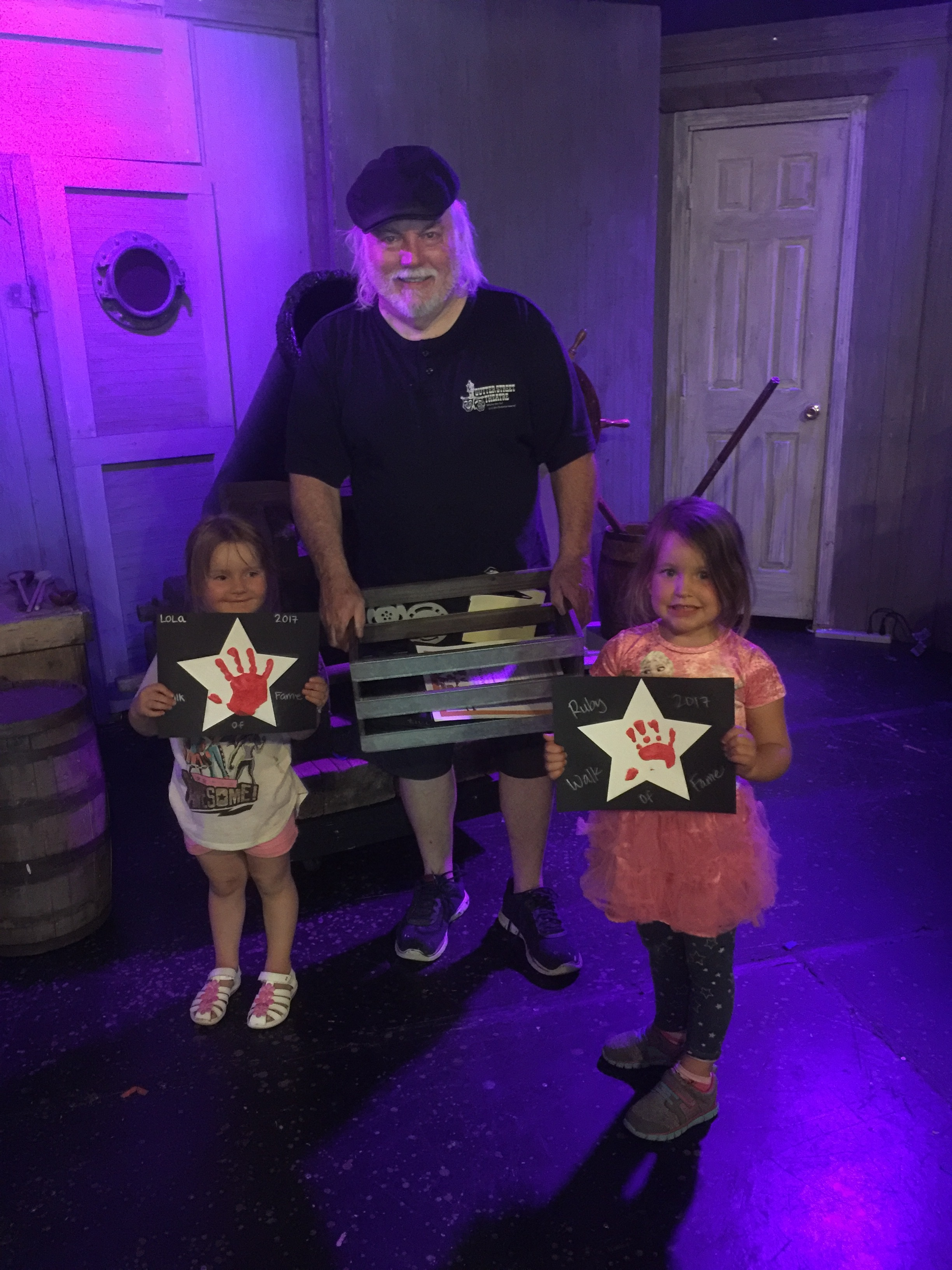 Addie and Dylan, of Madrone Montessori, presenting Sutter Street Theater's Artistic Director, Mike Jimena, with their school project.