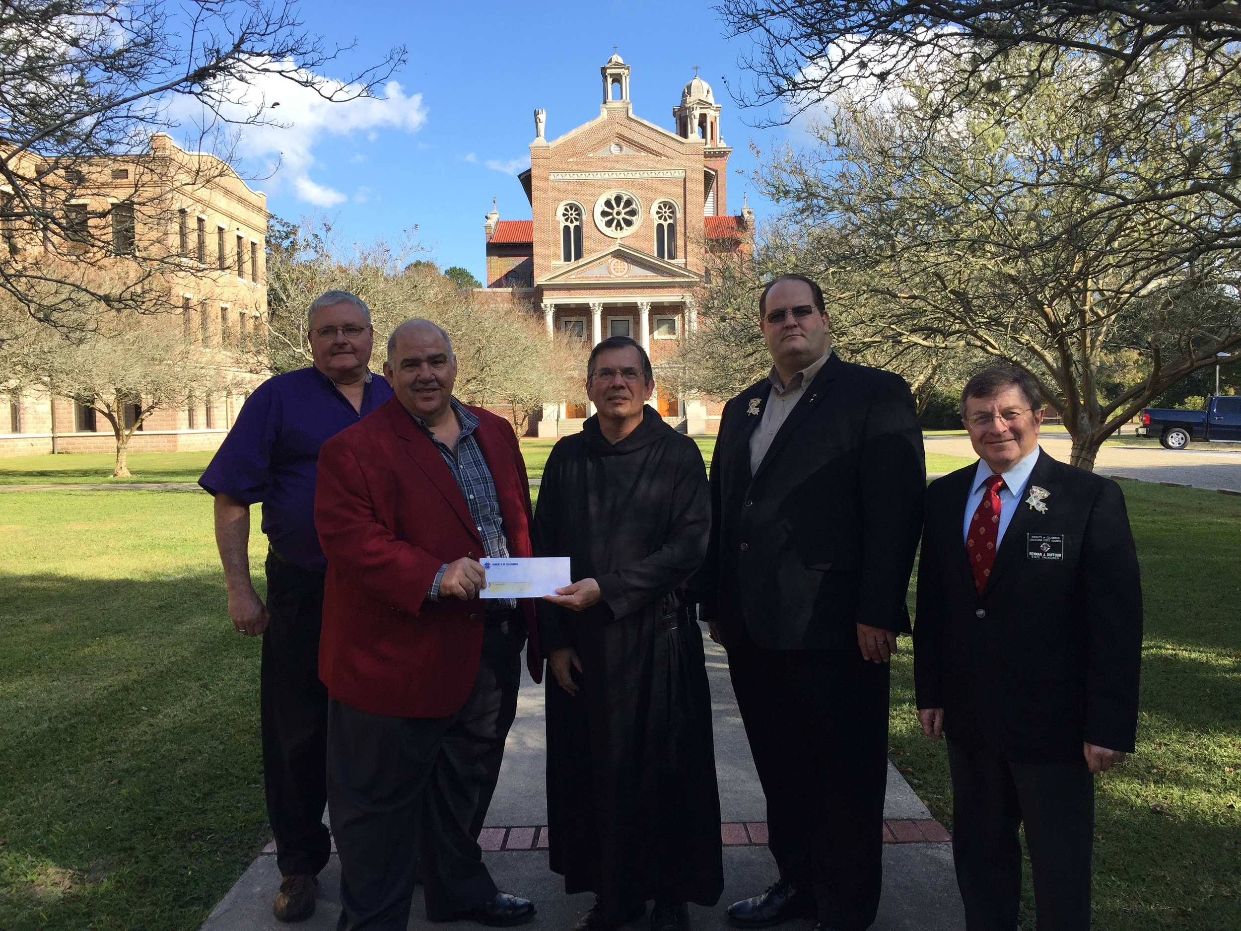 Saint Joseph Seminary College was presented a check for $20,000 from members of the Knights of Columbus Louisiana State Council. The donation will be used for the seminary's mission immersion program. From left to right are Keith Lawson, state warden, Delmas Forbes, Jr., seminarian mission fund chairman, Fr. Jude Israel, O.S.B., dean of students at Saint Joseph, Vernon Ducote, state deputy and Rennan Duffour, state treasurer.