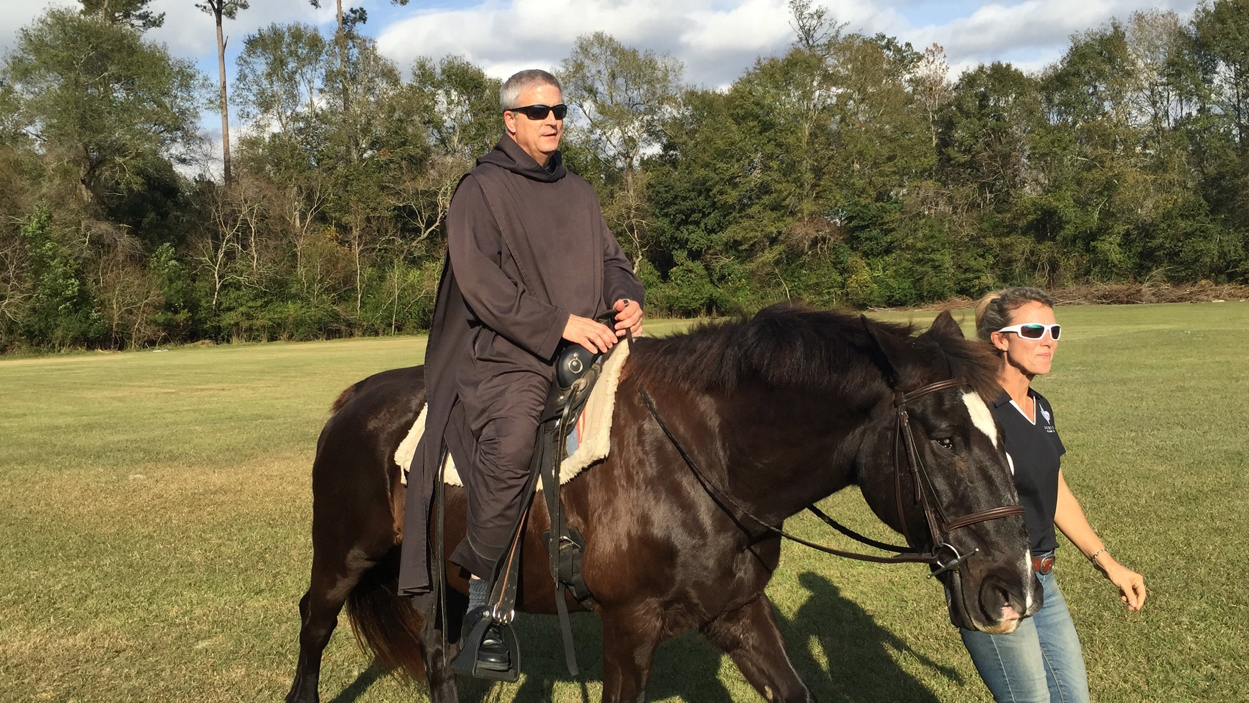 Fr. Gregory takes a ride last fall during the Horsemanship Program's class at Saint Joseph Abbey and Seminary College.