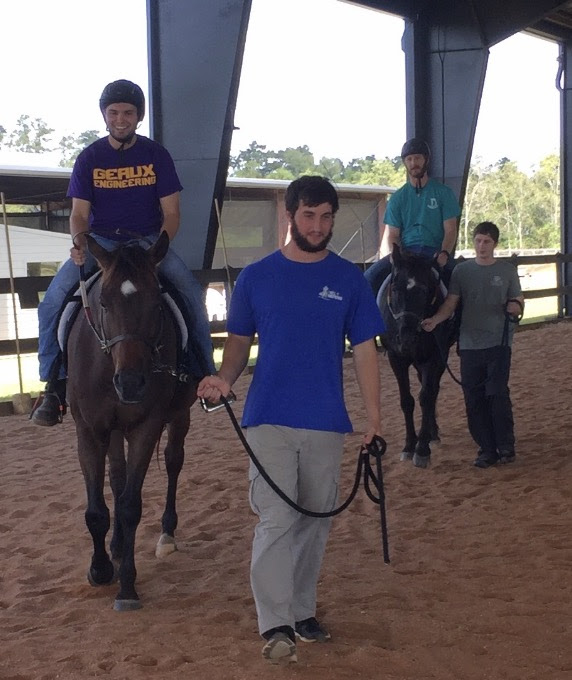 Alex and Dexter are the riders and Brice and Scott are the leaders; demonstrating some of what they do fore their Pastoral Ministry at New Heights Therapy Center..jpg