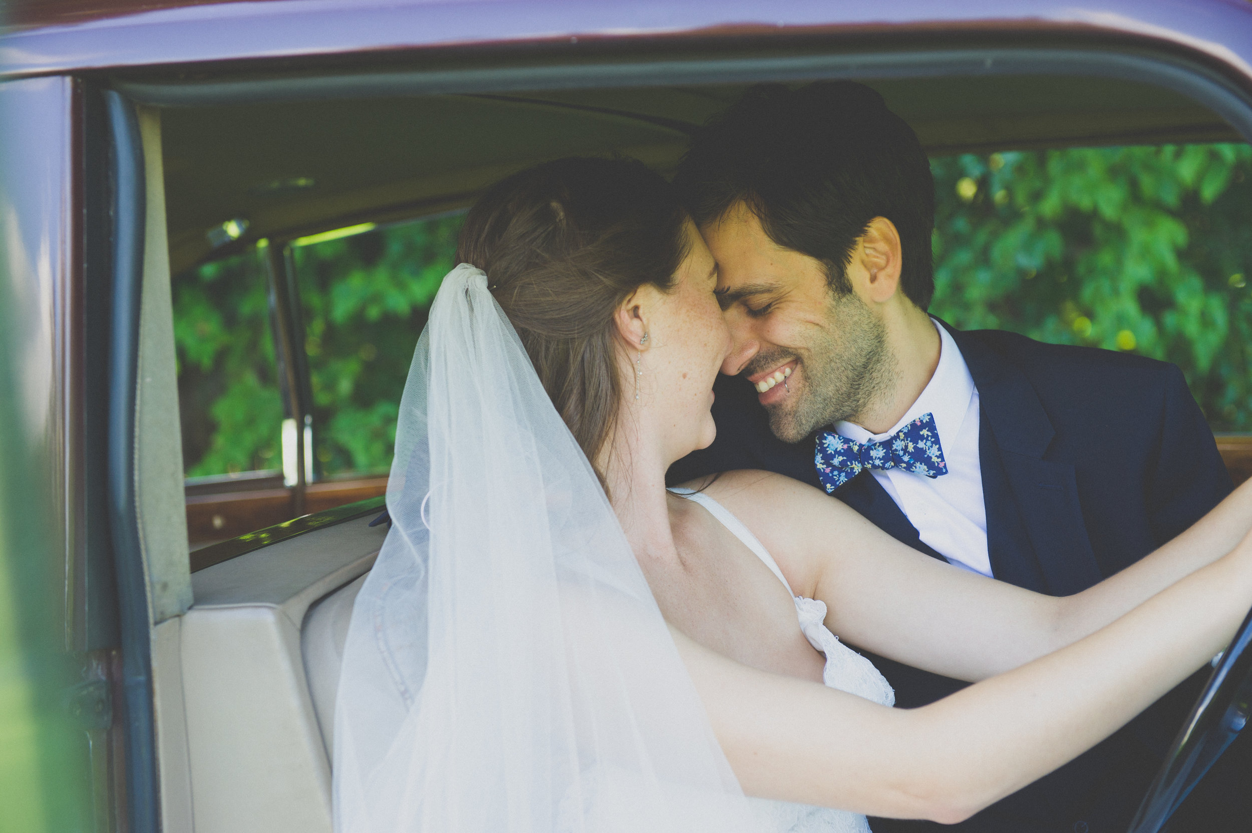 A little newlywed snuggle in the Rolls Royce! // Plant Based Bride // Shot by Karmel Kreative