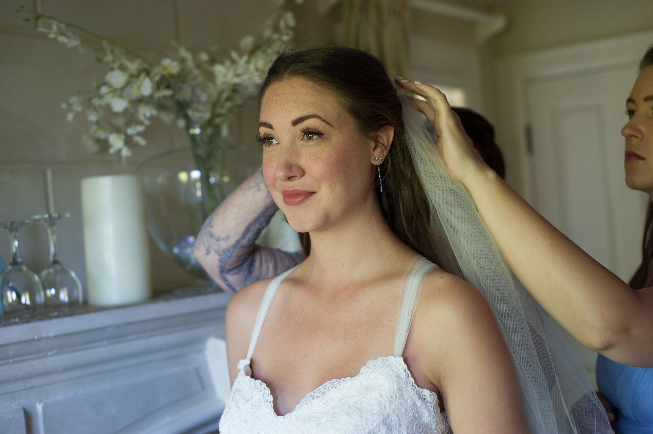 Mother of the bride and Maid of honour help the Bride get ready.  Wedding photography by Karmel Kreative // Plant Based Bride