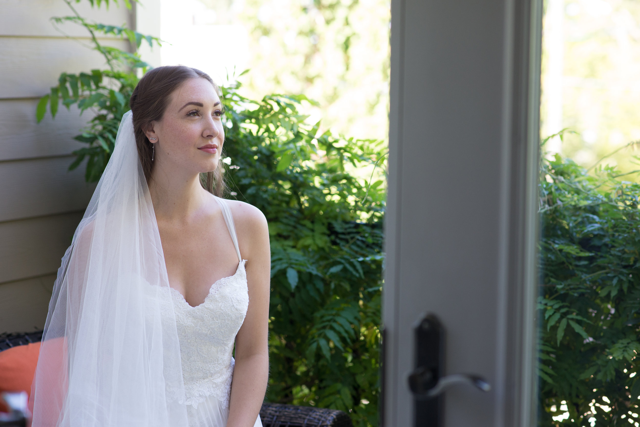 The Bride waits for the car to take her to her wedding.  Wedding photography by Karmel Kreative // Plant Based Bride