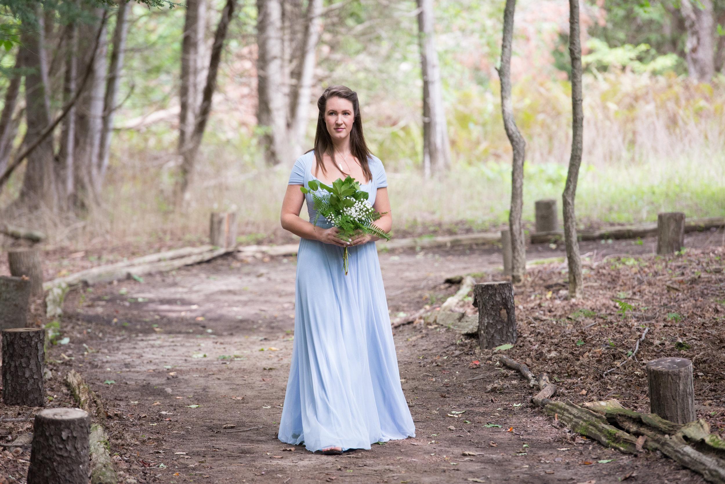 The maid of honour walks down the aisle. // Wedding photos by Karmel Kreative // Plant Based Bride
