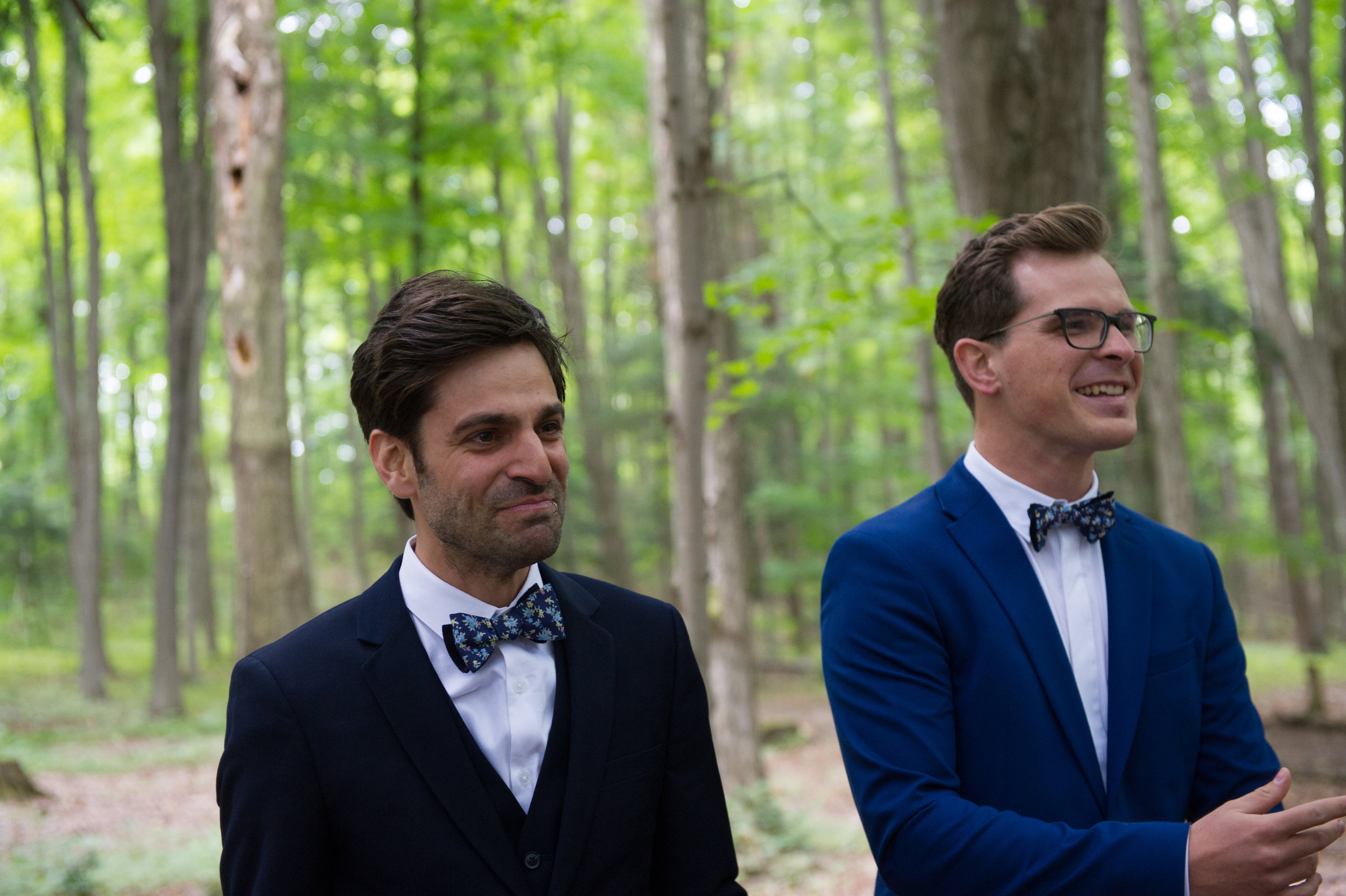 The groom and best man watch the bride and her father walk down the aisle.  // Wedding photos by Karmel Kreative // Plant Based Bride