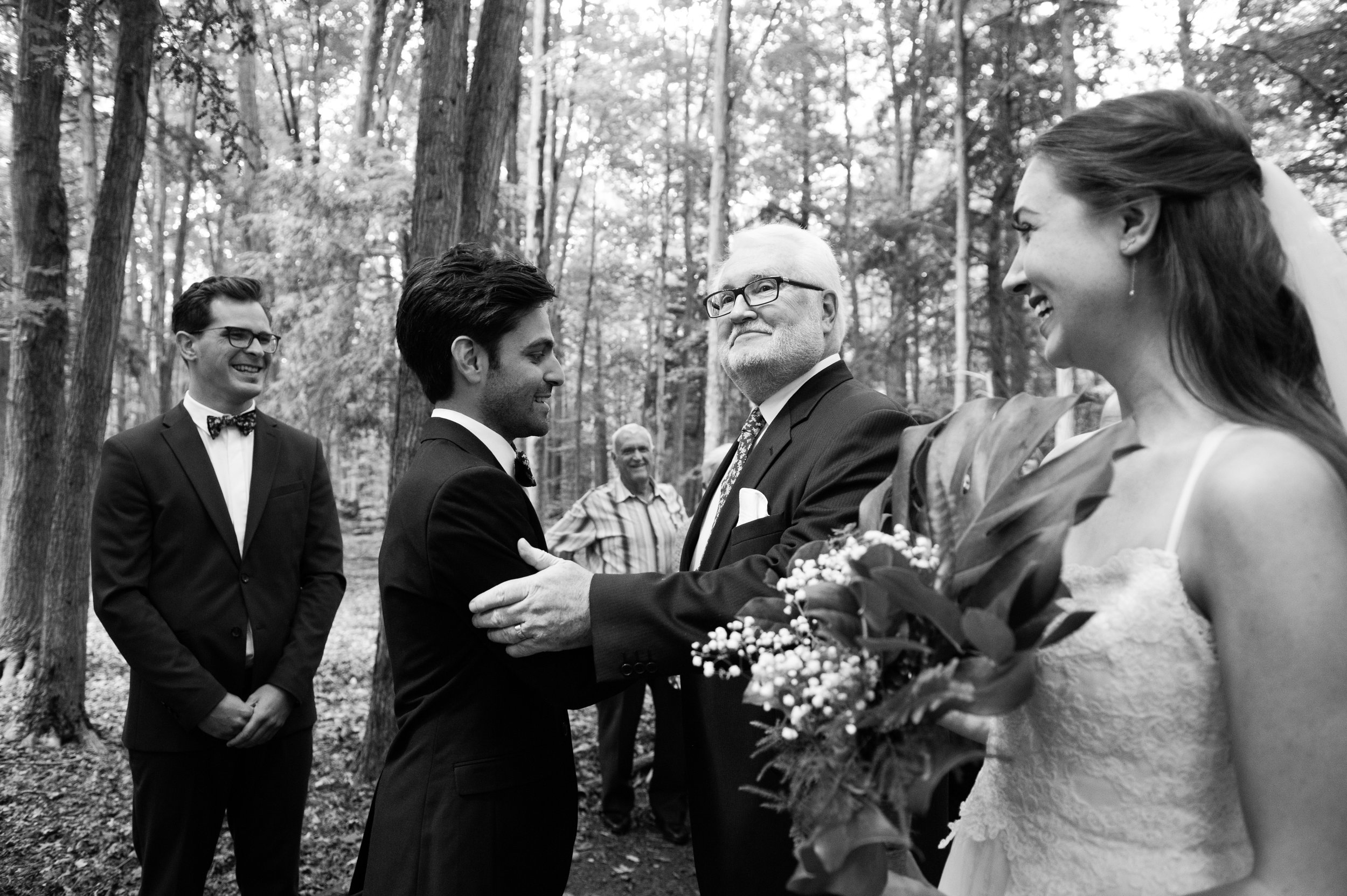 The father of the bride shakes the groom's hand. // Wedding photos by Karmel Kreative // Plant Based Bride