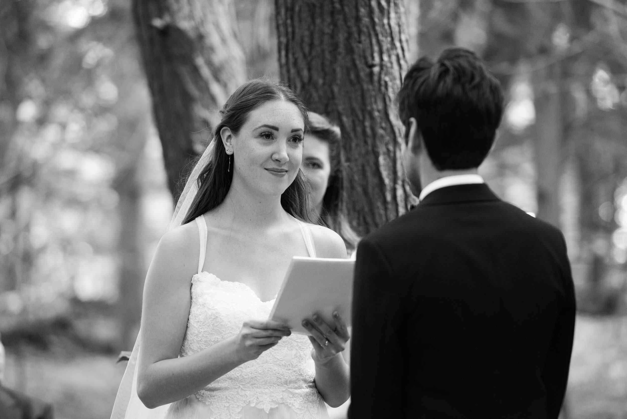 The bride reads her vows. // Wedding photos by Karmel Kreative // Plant Based Bride
