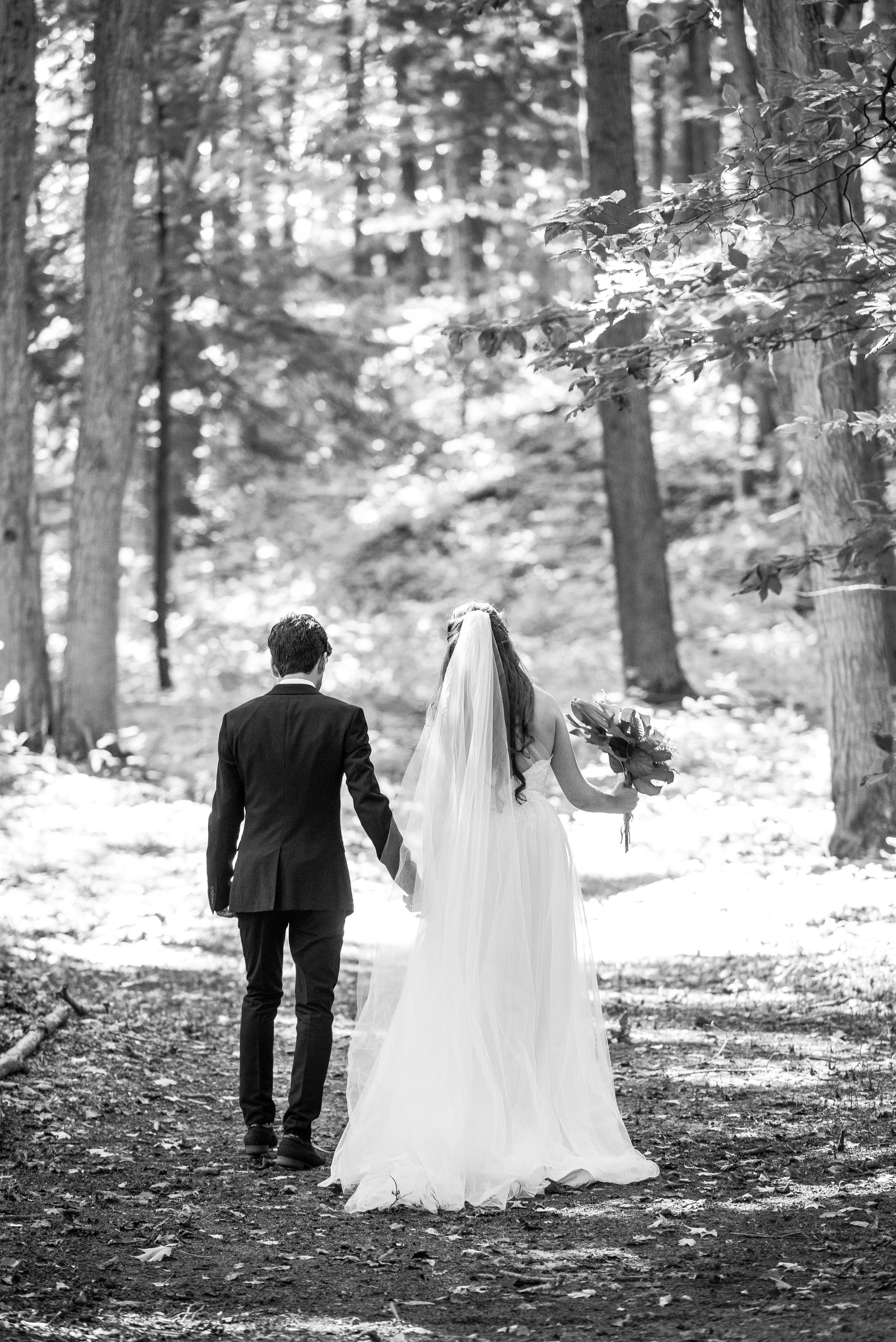 The bride and the groom go off into the forest. // Wedding photos by Karmel Kreative // Plant Based Bride