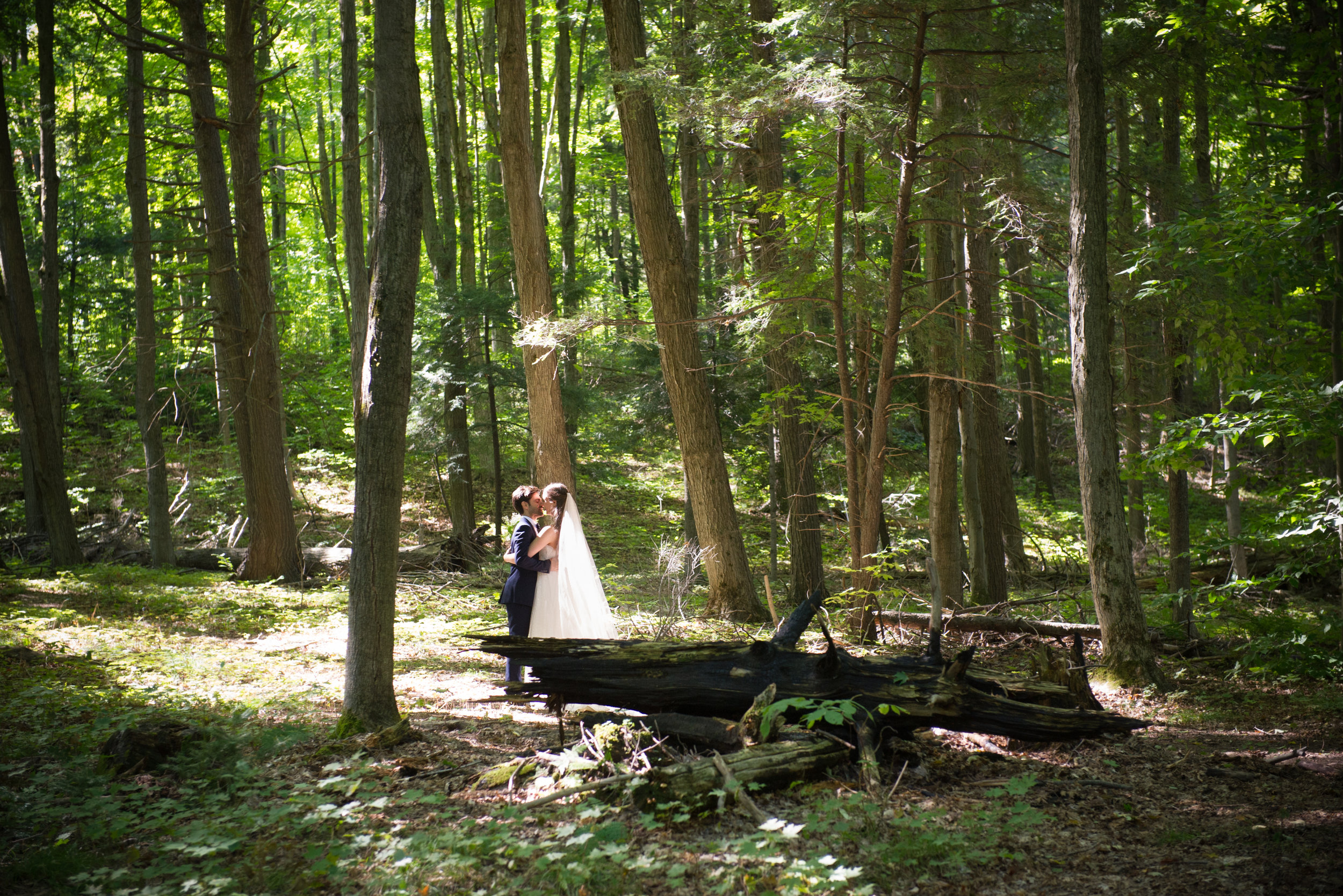 The bride and the groom in the forest. // Wedding photos by Karmel Kreative // Plant Based Bride