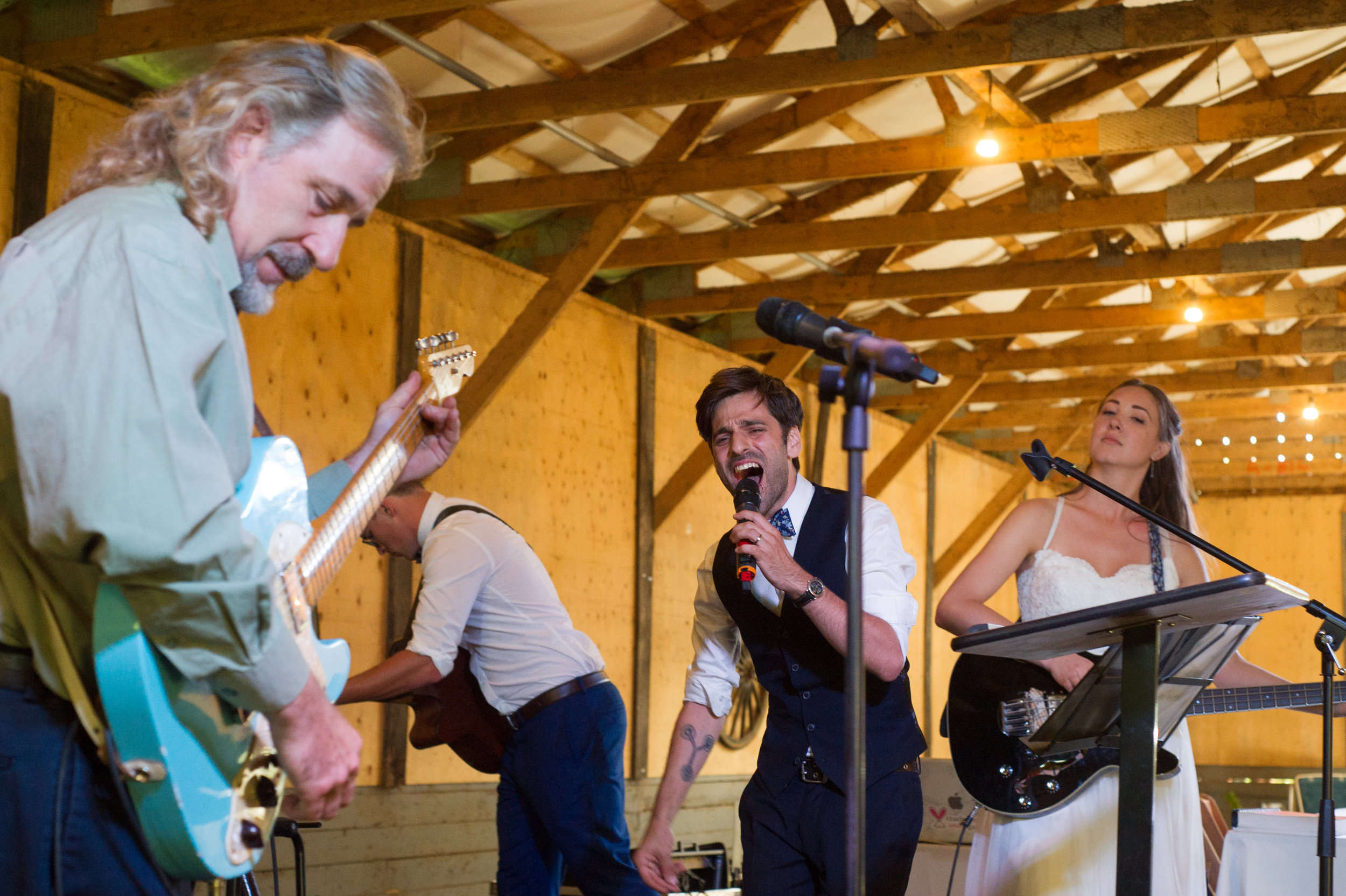 The newlyweds rock it out.  // Wedding photos by Karmel Kreative // Plant Based Bride