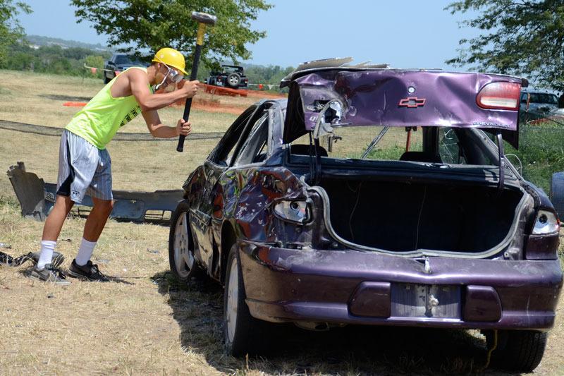 Man smashing purple car