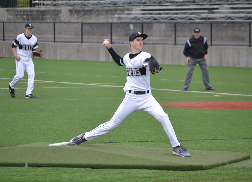 Alex Hurlburt pitches in a game. Photo by Ed Hurlburt.
