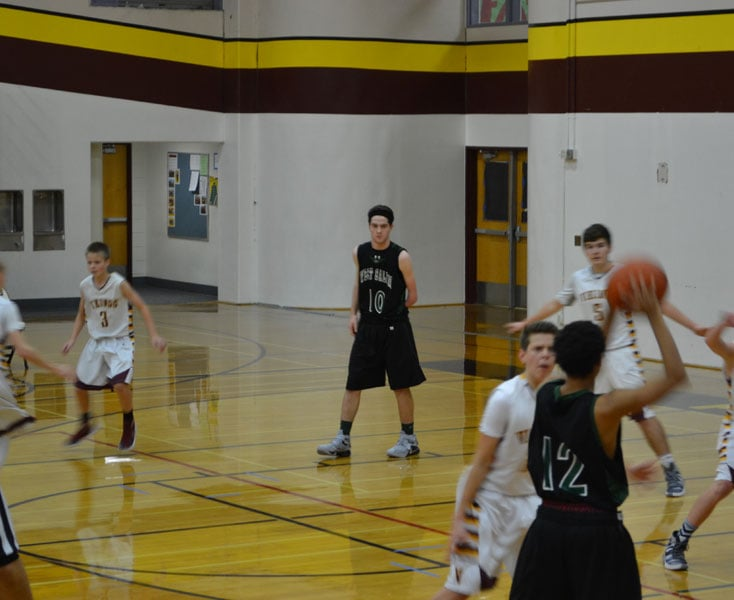 #10 Alex Hurlburt in a freshman basketball game. Photo by Ed Hurlburt.