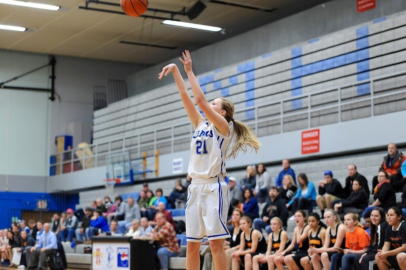 Madi Hingston #21 hits a huge three-point shot at a home game.