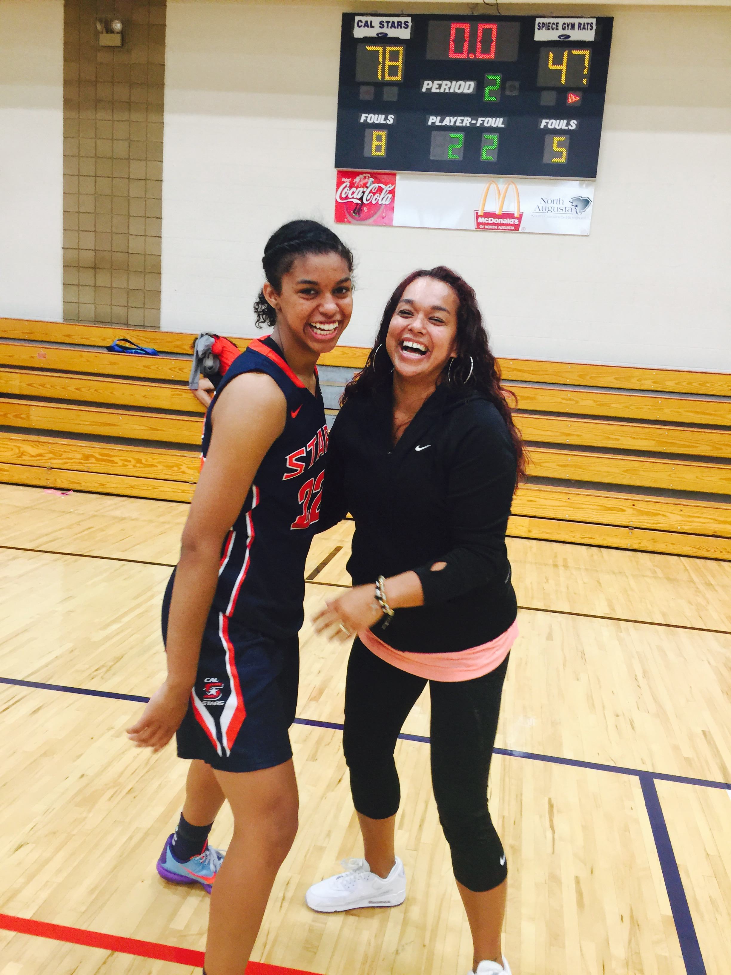 Evina Westbrook #22 and her mom, Eva, celebrating a win.
