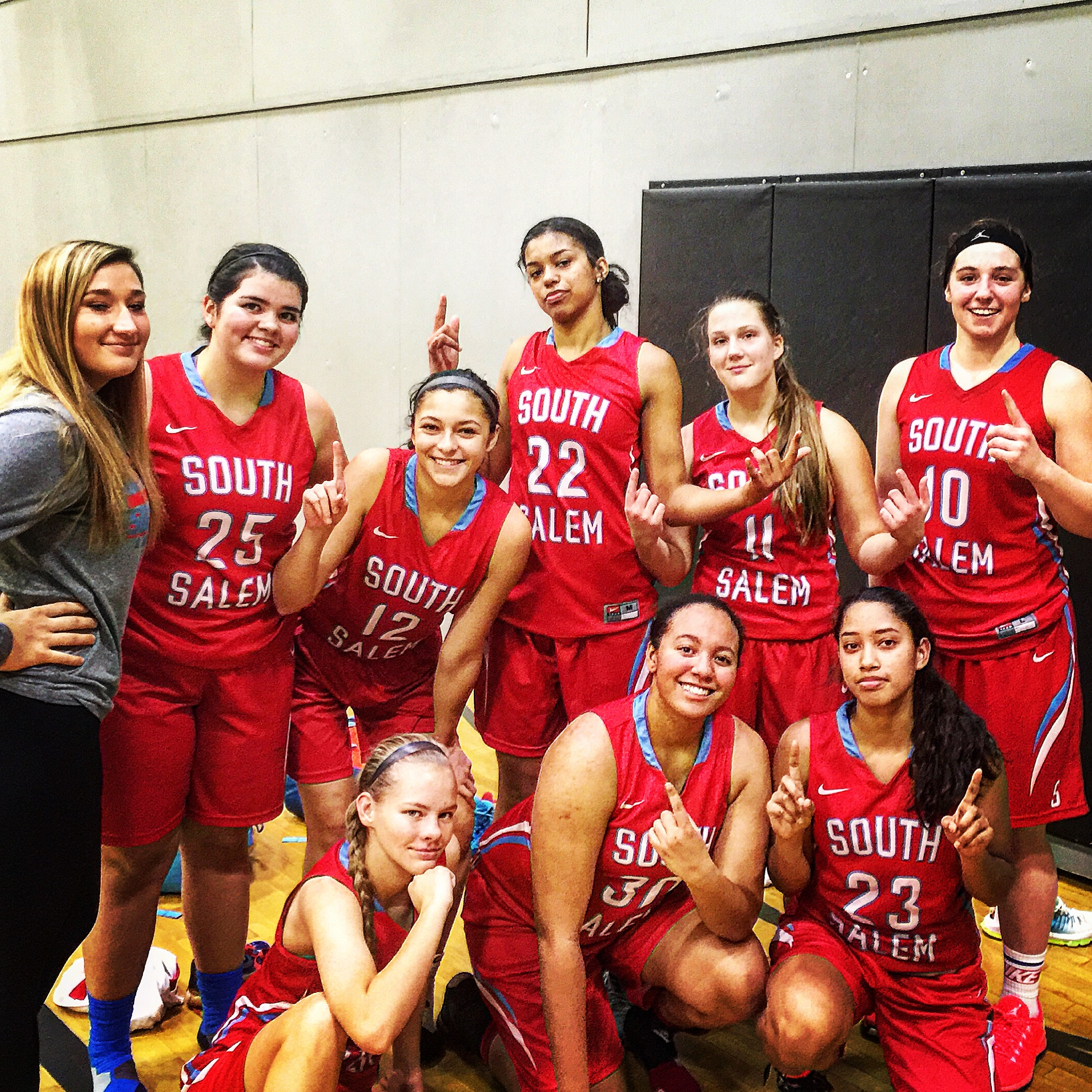 Evina #22 with her teammates after the comeback win at the Fitzgerald Tourney.