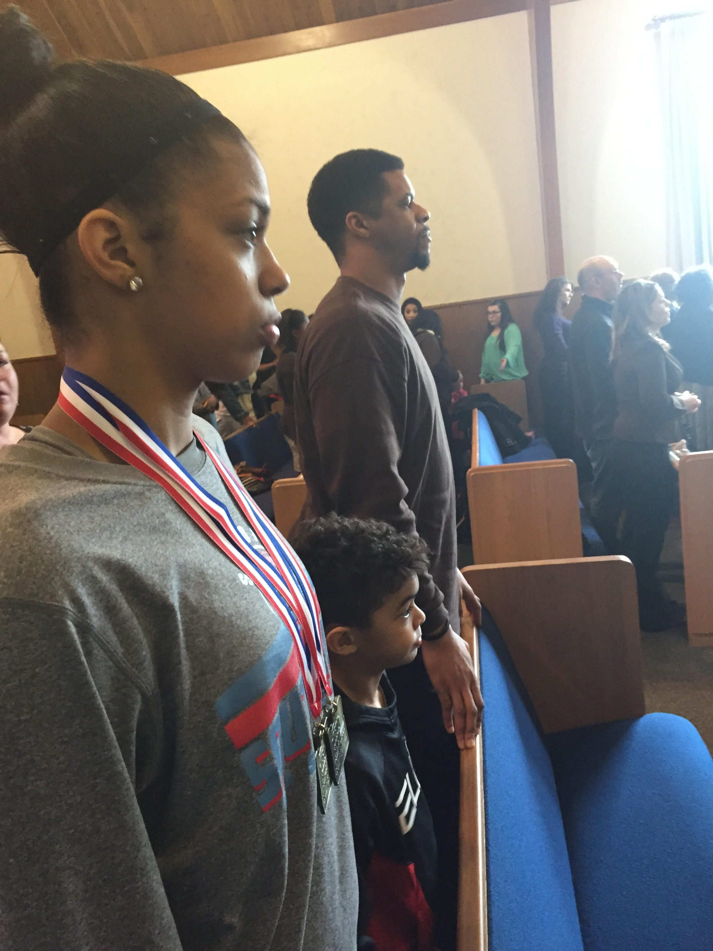 Evina at church with her dad, James and brother TKO after the State Title game.