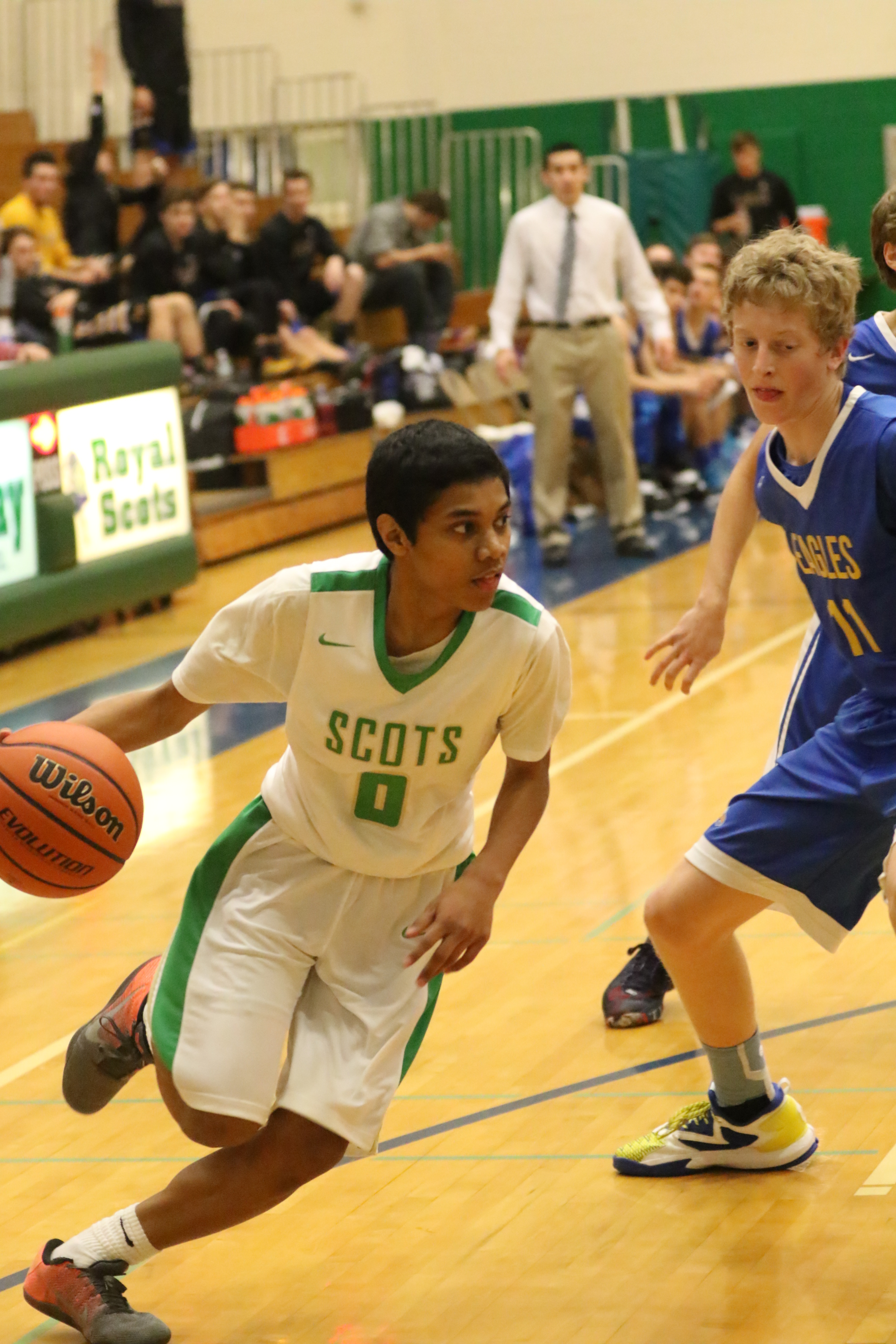 Drioji drives to the basket. Photo by Kent Brewer.