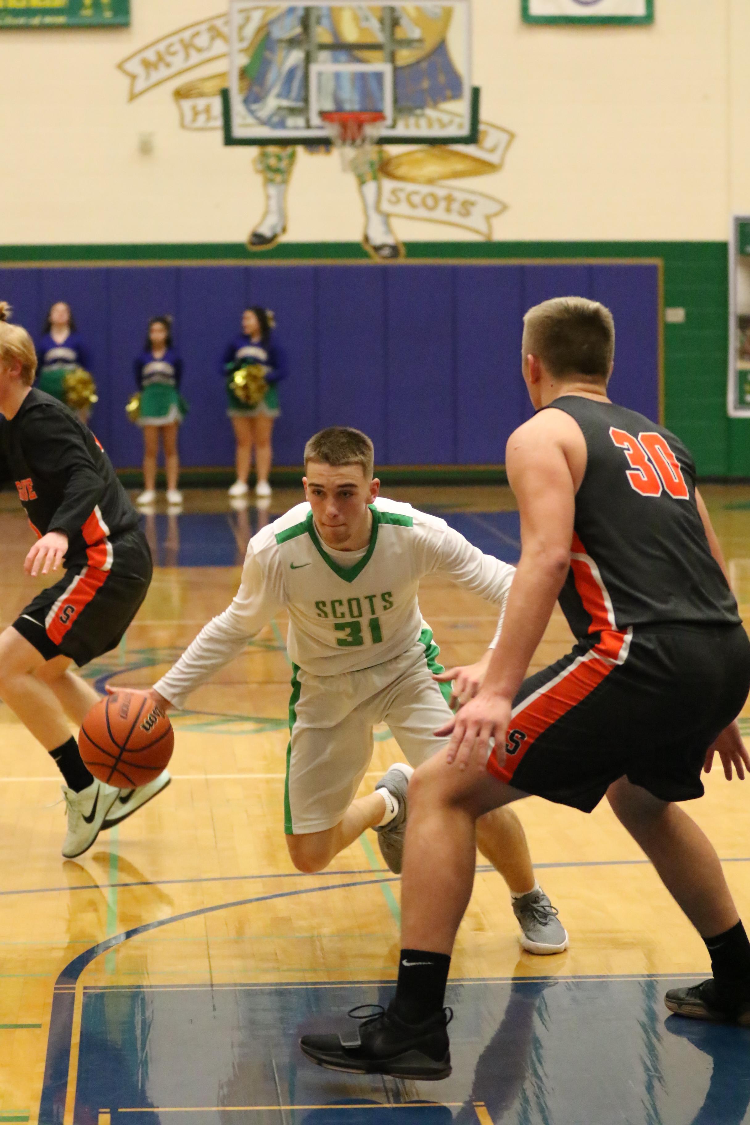 Ryan Bangs taking it to the basket. Photo by Kent Brewer.