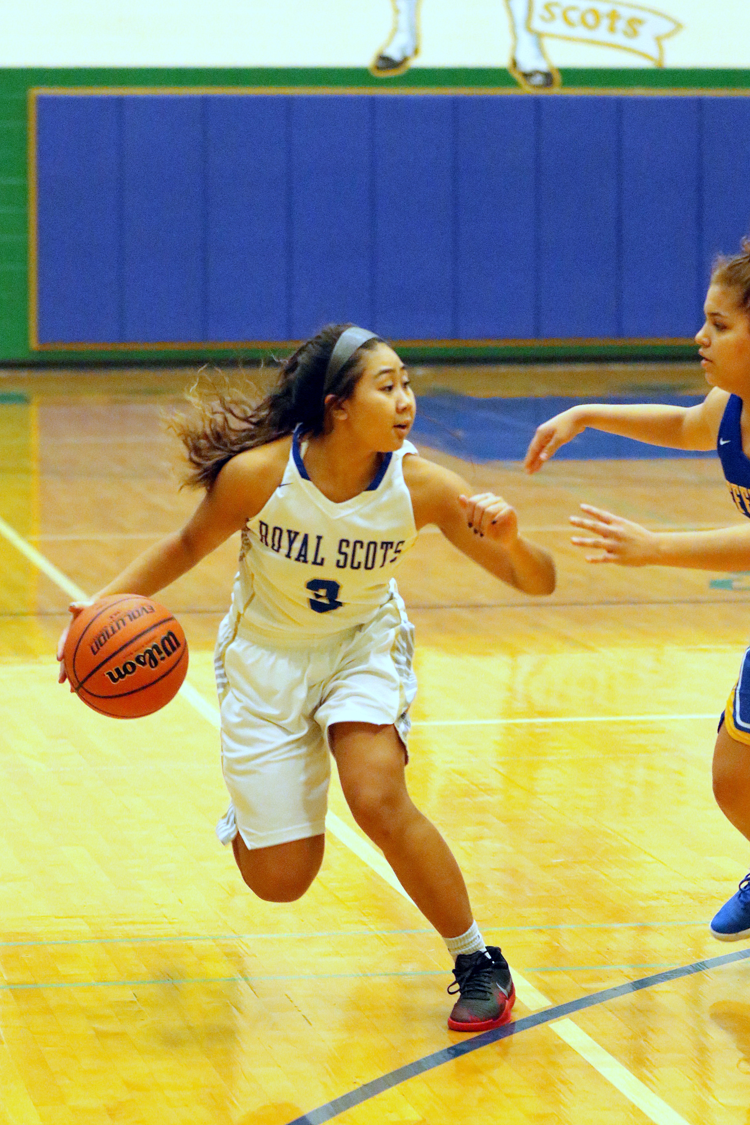 #3 Anita Lao drives against Jefferson. Photo by Kent Brewer.