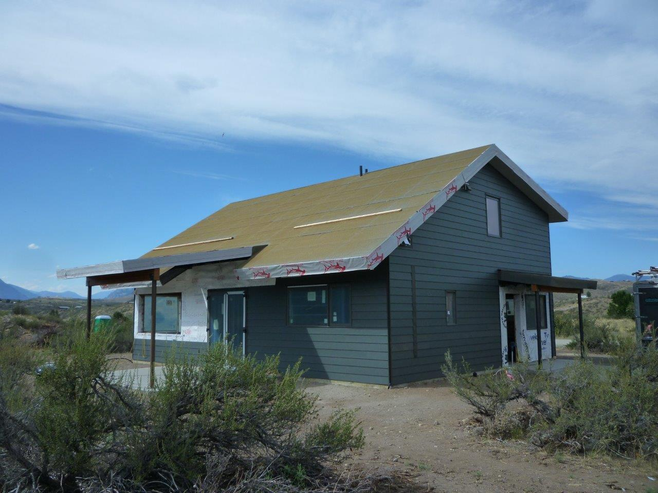 The south side of our zero-energy house, with covered porch.