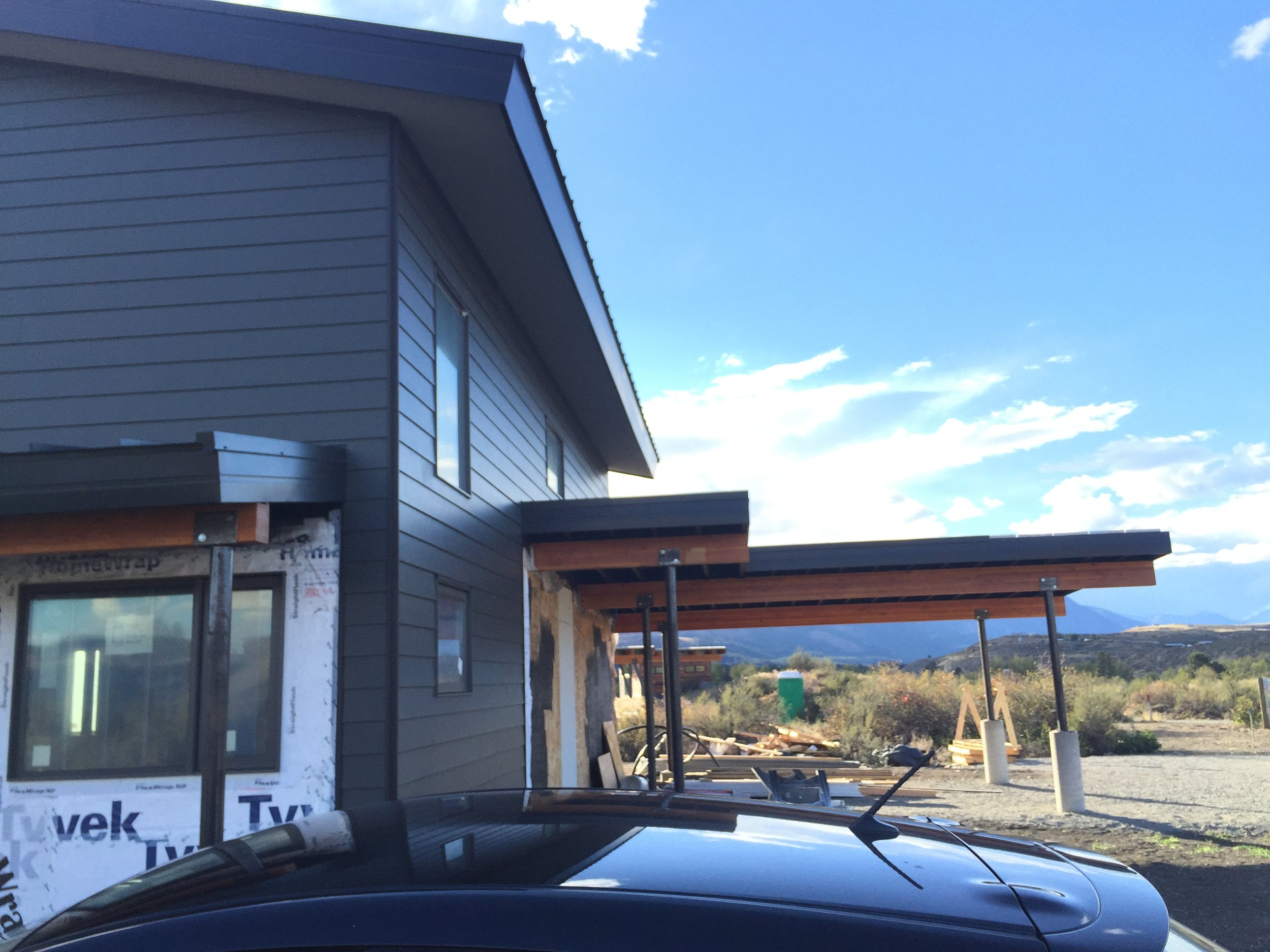 The carport will eventually have enclosed storage for skis and bikes under the section closest to the house.