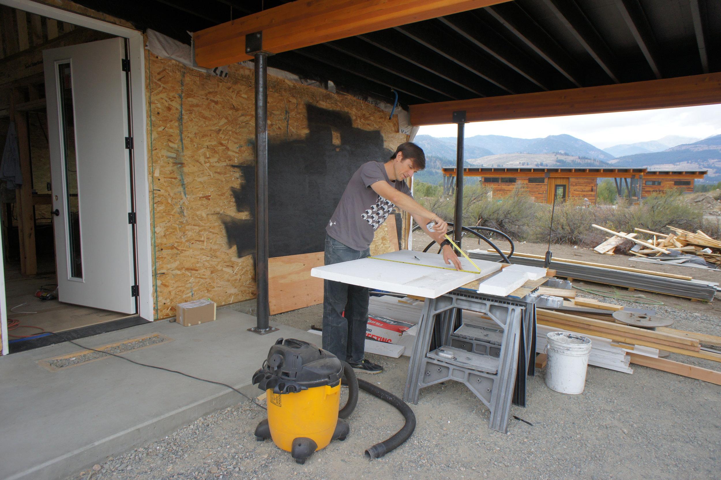 Eric cutting rigid foam for the rim joist insulation.