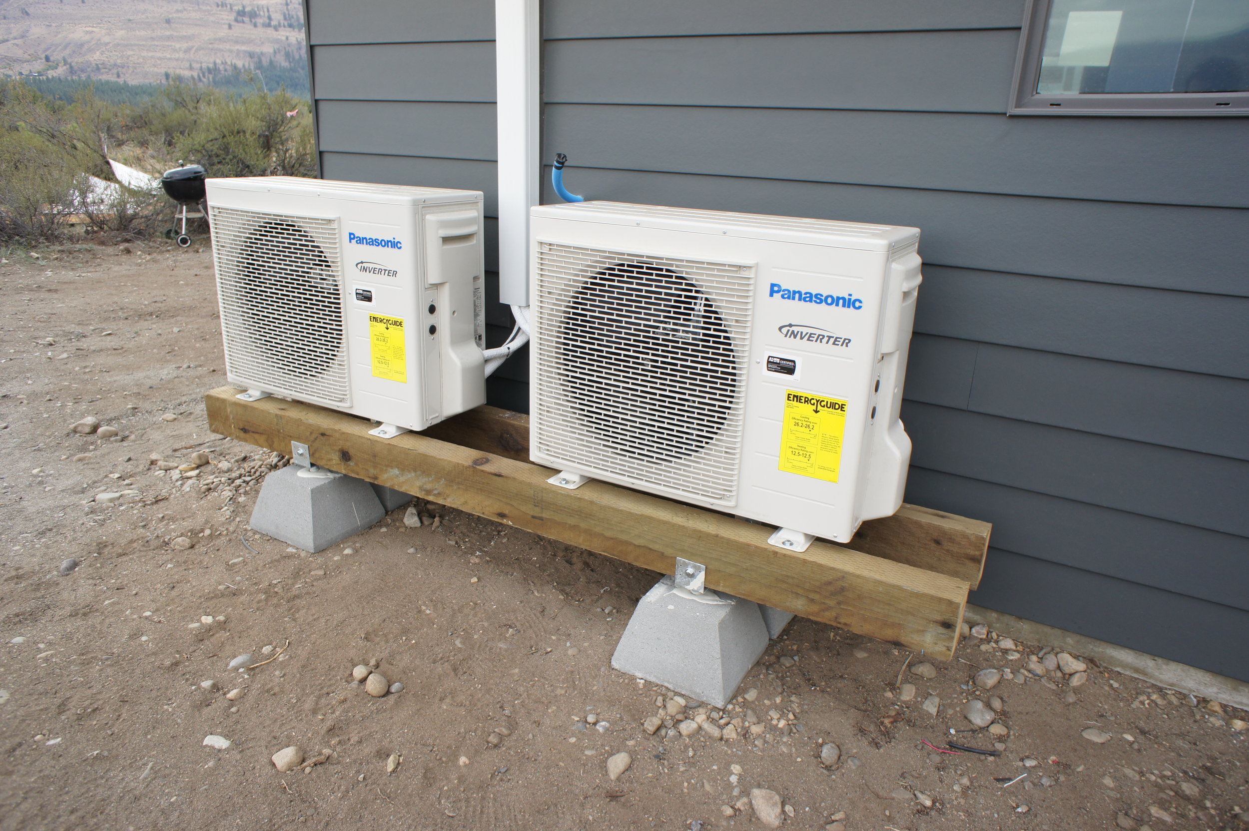 """These outdoor heat pump units connect to """"heads"""" inside the house."""