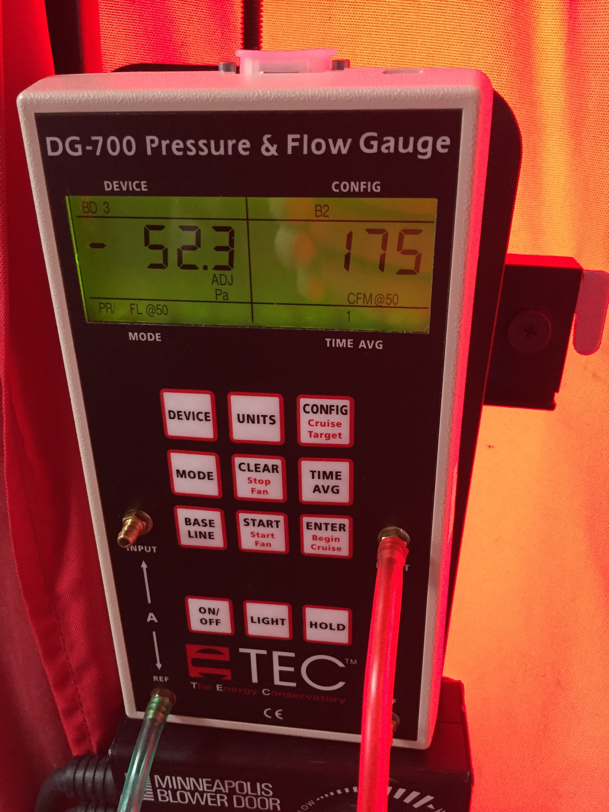 Our blower door results are in, and we're very pleased with them. To calculate air changes per hour (ACH), we multiplied the CFM number on the right by 60 and divided by the number of cubic feet of the house.