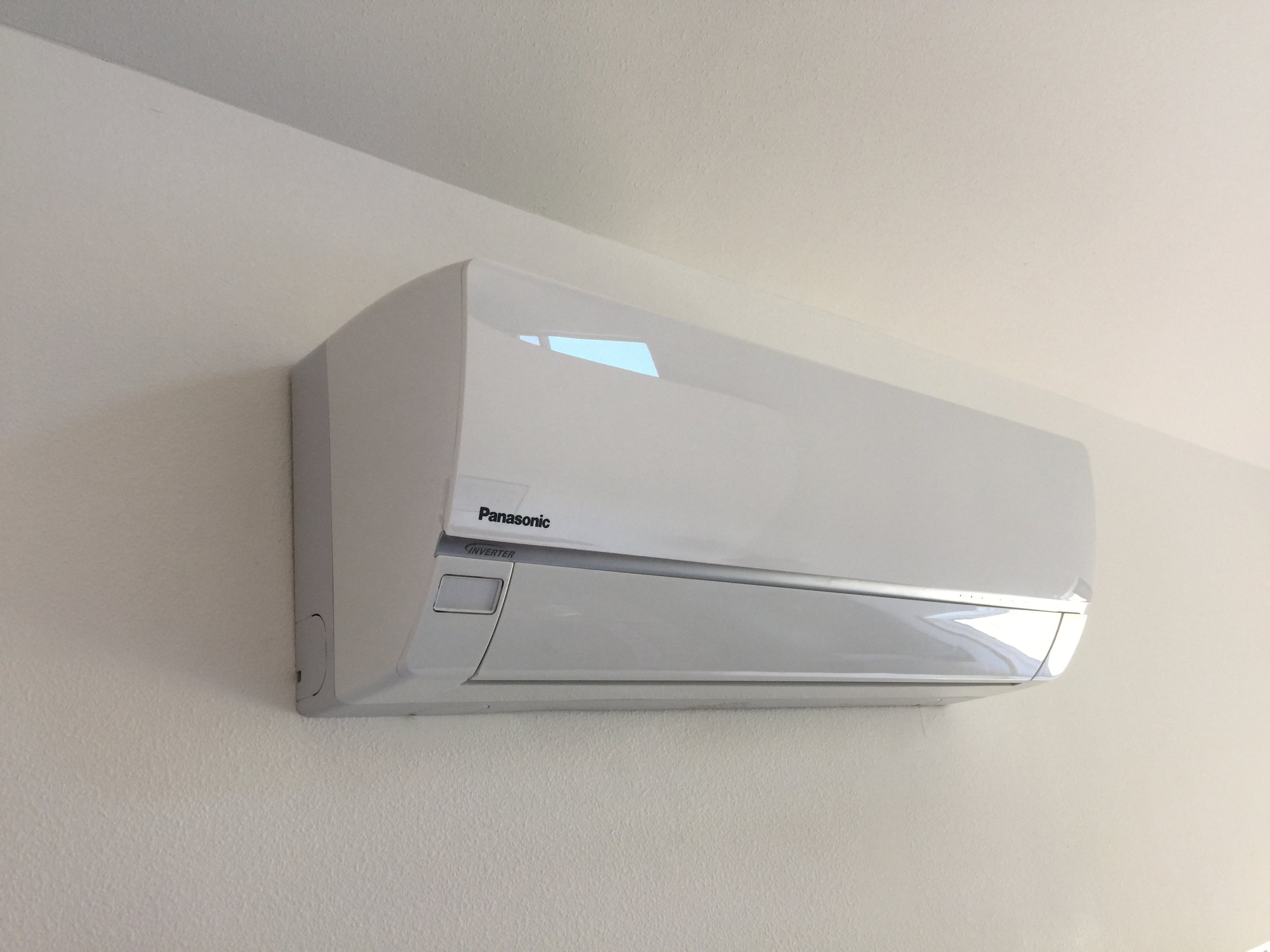 The indoor unit of the Panasonic Exterios Heat Pump. Some people are bothered by seeing these on their walls, but I think they look rather sleek and futuristic.