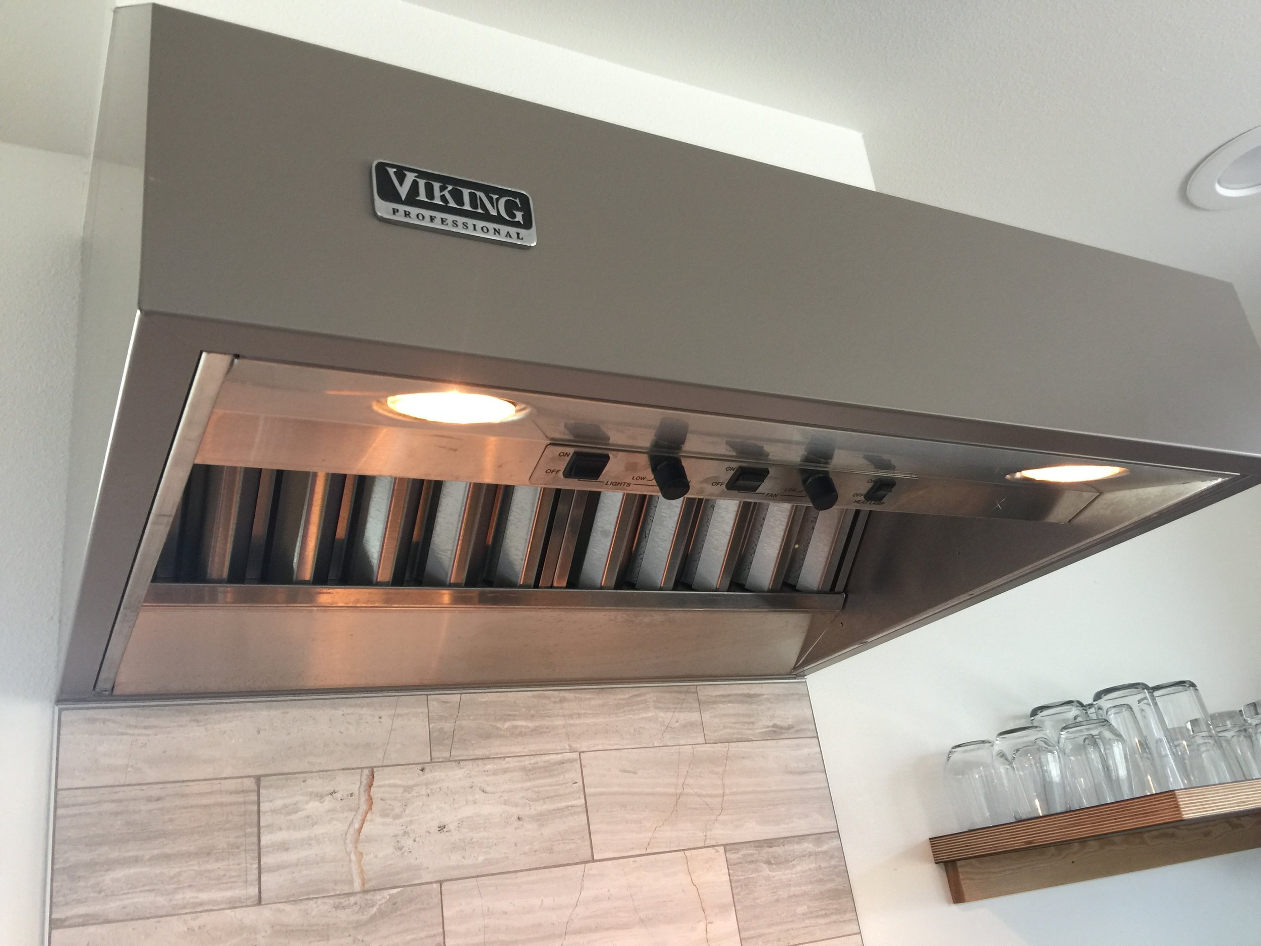 On/off and speed controls are integrated into the Viking range hood.
