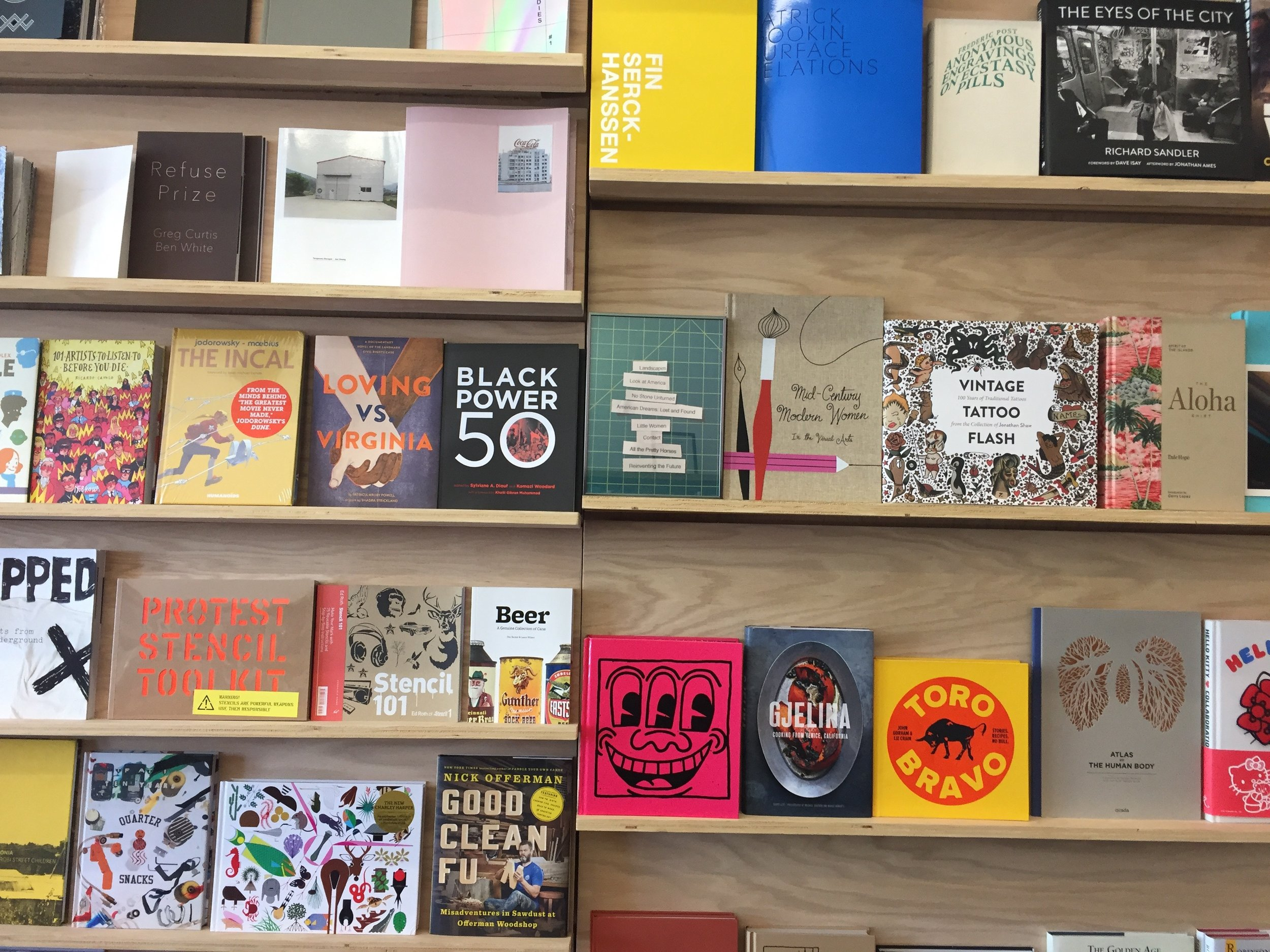 Double Positive,  2017  Sandstone, felt, used books, poem,framed ink jet prints  Installed in PopHop Books, Los Angeles, 2017  In collaboration with  Susanna Battin
