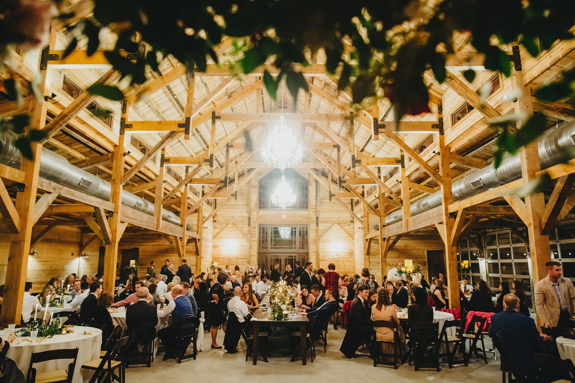 dinner and reception set up in  The Addison Grove barn.