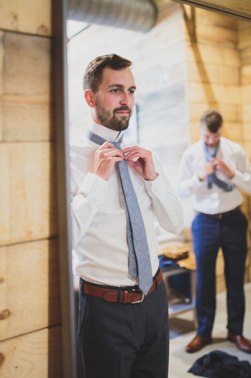 Alex prepping his tie in  The Addison Grove grooms room.