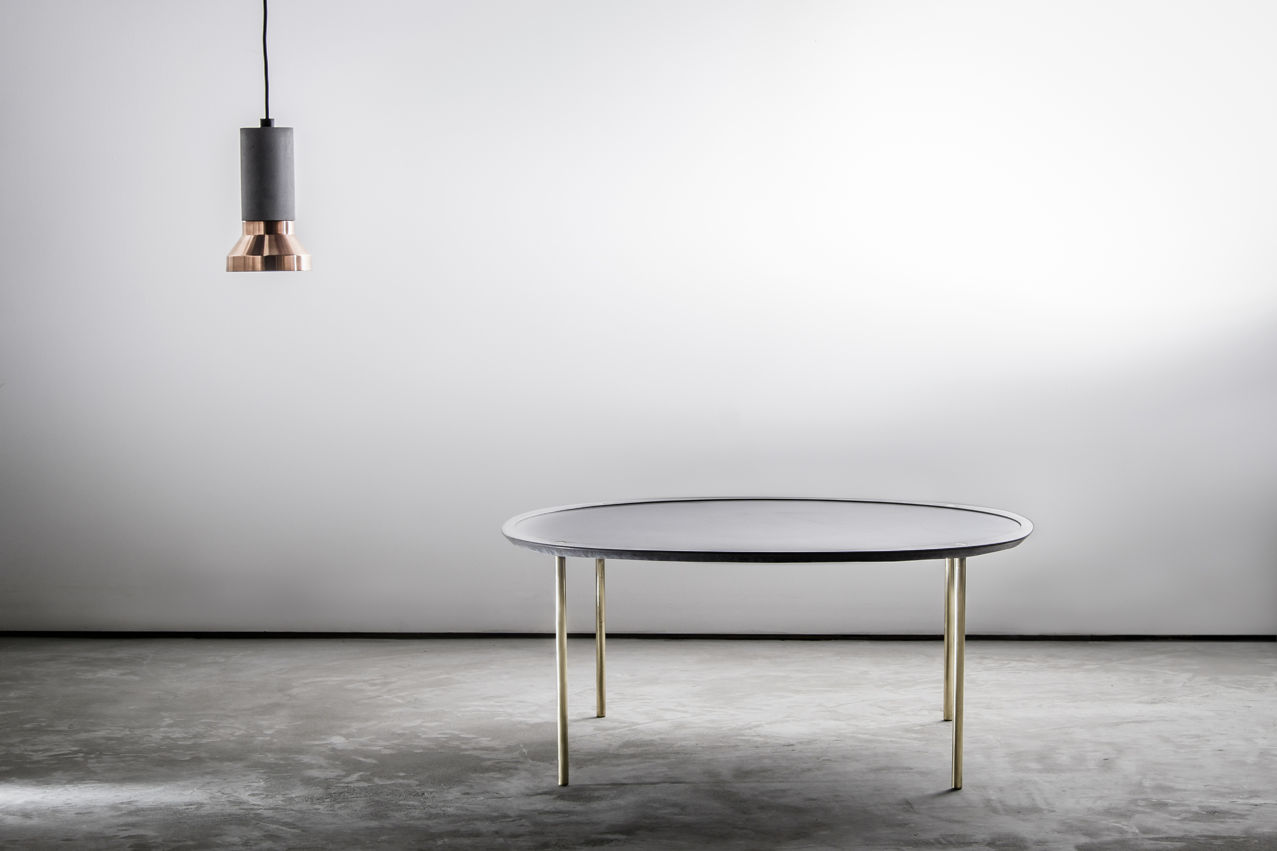 Spun Concrete Pendant Light with Messinki Concrete Coffee Table